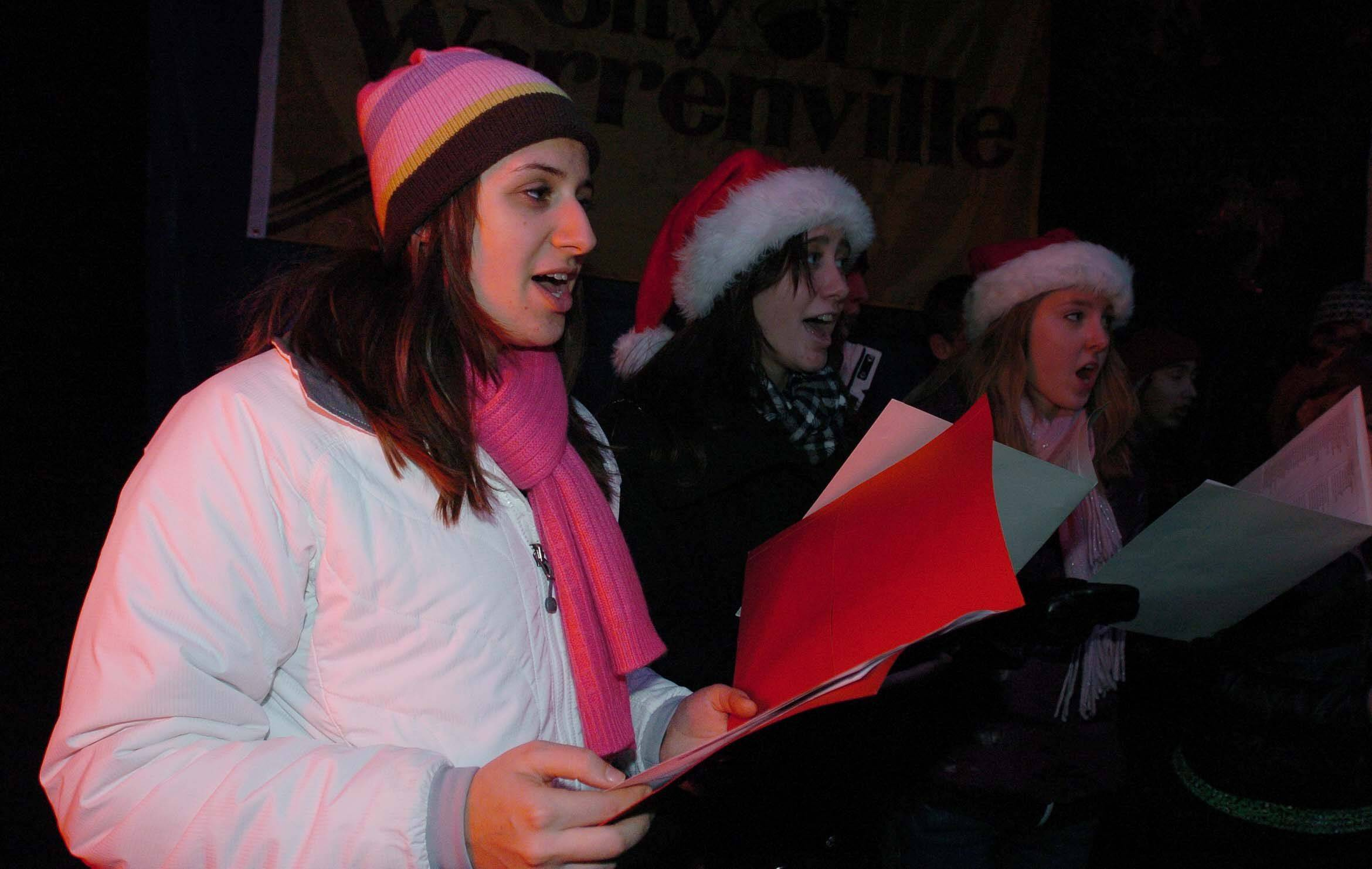 Lauren Molinaro of Wheaton Warrenville South High School choir sings during Holly Days in Warrenville Friday.