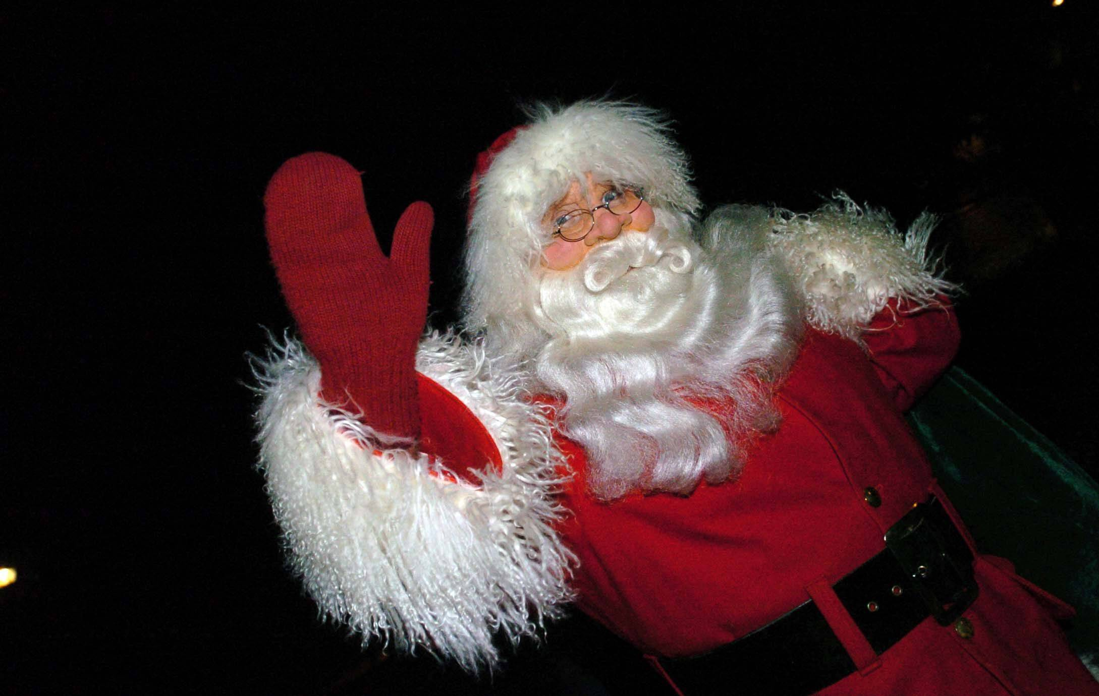 Santa waves during Holly Days in Warrenville Friday.
