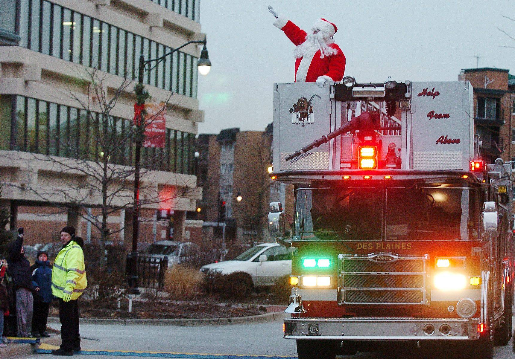 Santa arrives via fire truck to the Des Plaines Christmas tree lighting street fest at Metropolitan Square.