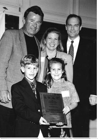 Legendary Cubs third baseman Ron Santo, top left, presented the Helme family of Western Springs an award for having the most participants at a 1998 charity walk. Daughter Kady Helme, bottom right, was diagnosed with the disease when she was 5 and the rest of the family, brother Joey, mother Kassy and father Joe also participate in the annual event.