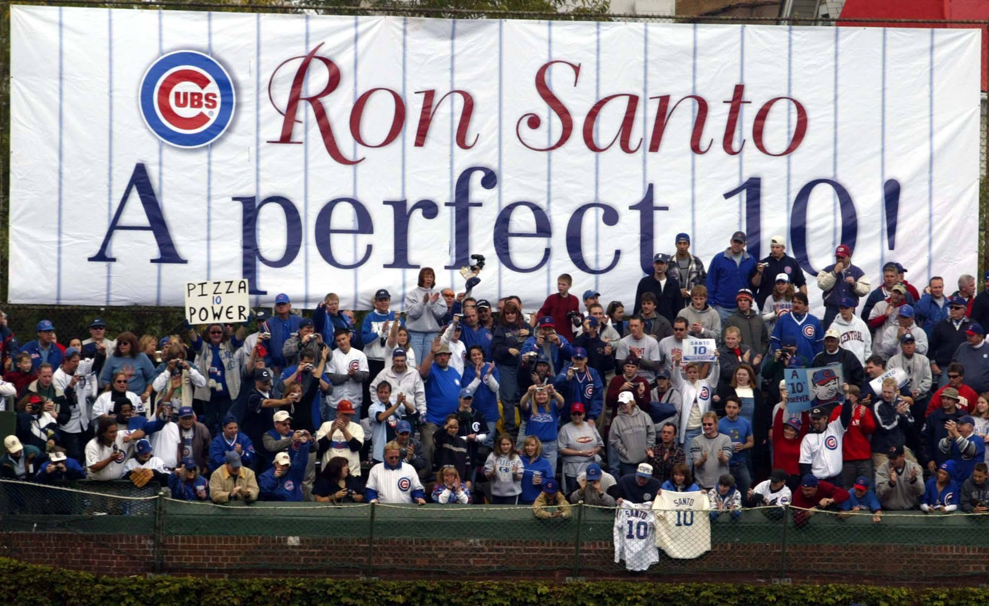Left-field bleacher fans acknowledge Ron Santo as he circles Wrigley Field in a golf cart following the retiring of Santo's #10 jersey in 2003.