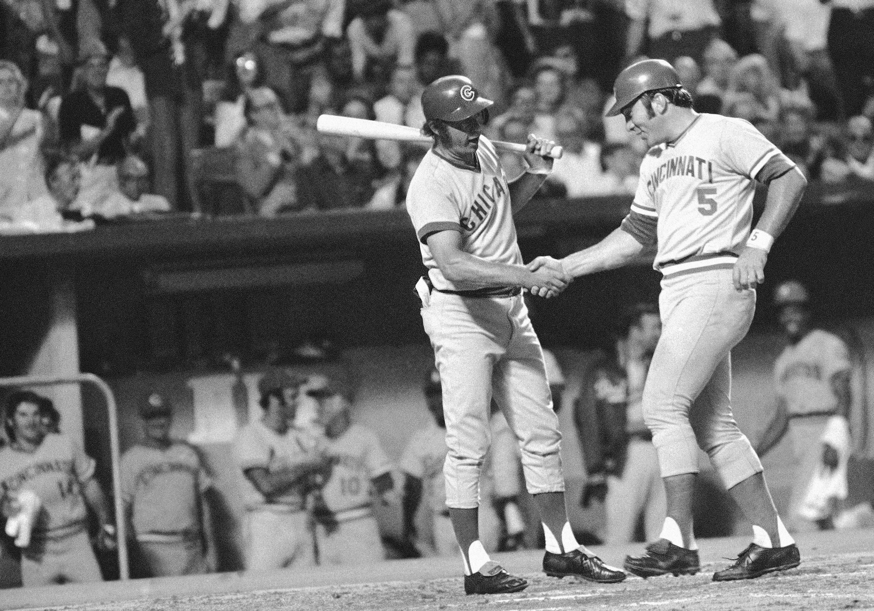 Johnny Bench (5) of Cincinnati Reds is greeted at plate by Ron Santo of Chicago Cubs after Bench scored a home run for the National League in the fourth inning of the 44th All-Star game at Royals Stadium, Tuesday, July 25, 1973, Kansas City, Mo. The National League won, 7-1, to capture its 10th victory in last 11 All-Star Games.