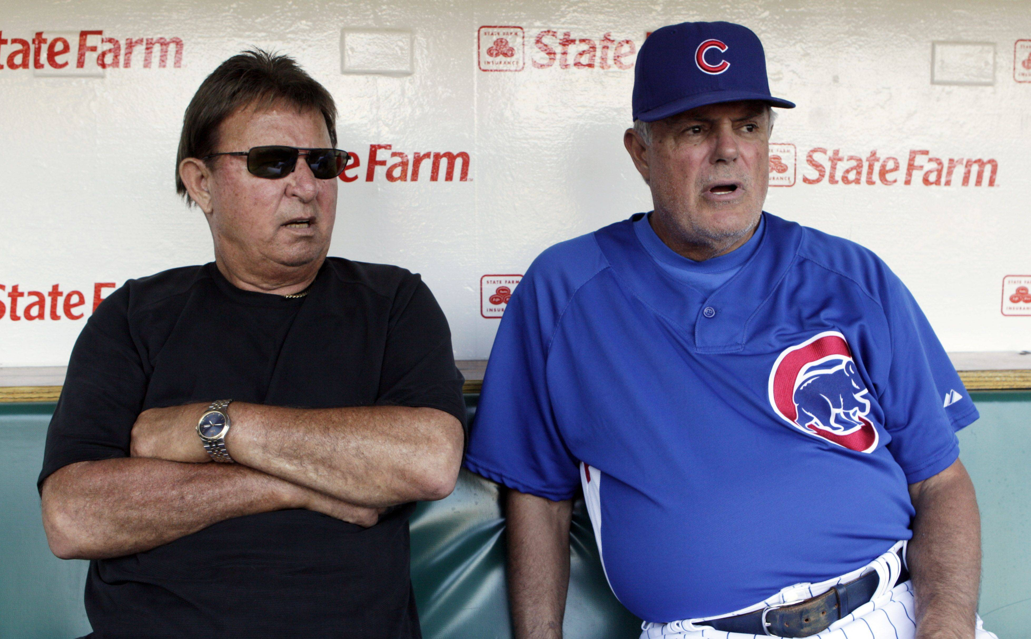 In this photograph taken on Aug. 12, 2009, Chicago Cubs radio broadcaster Ron Santo, left, sits in the dugout with Cubs manager Lou Pinella before a baseball game at Wrigley Field in Chicago. The 69-year-old Santo, who joined the team as a 20-year-old rookie in 1960, is in his 20th year as a broadcaster and still rooting for the team he has never seen play in the World Series.