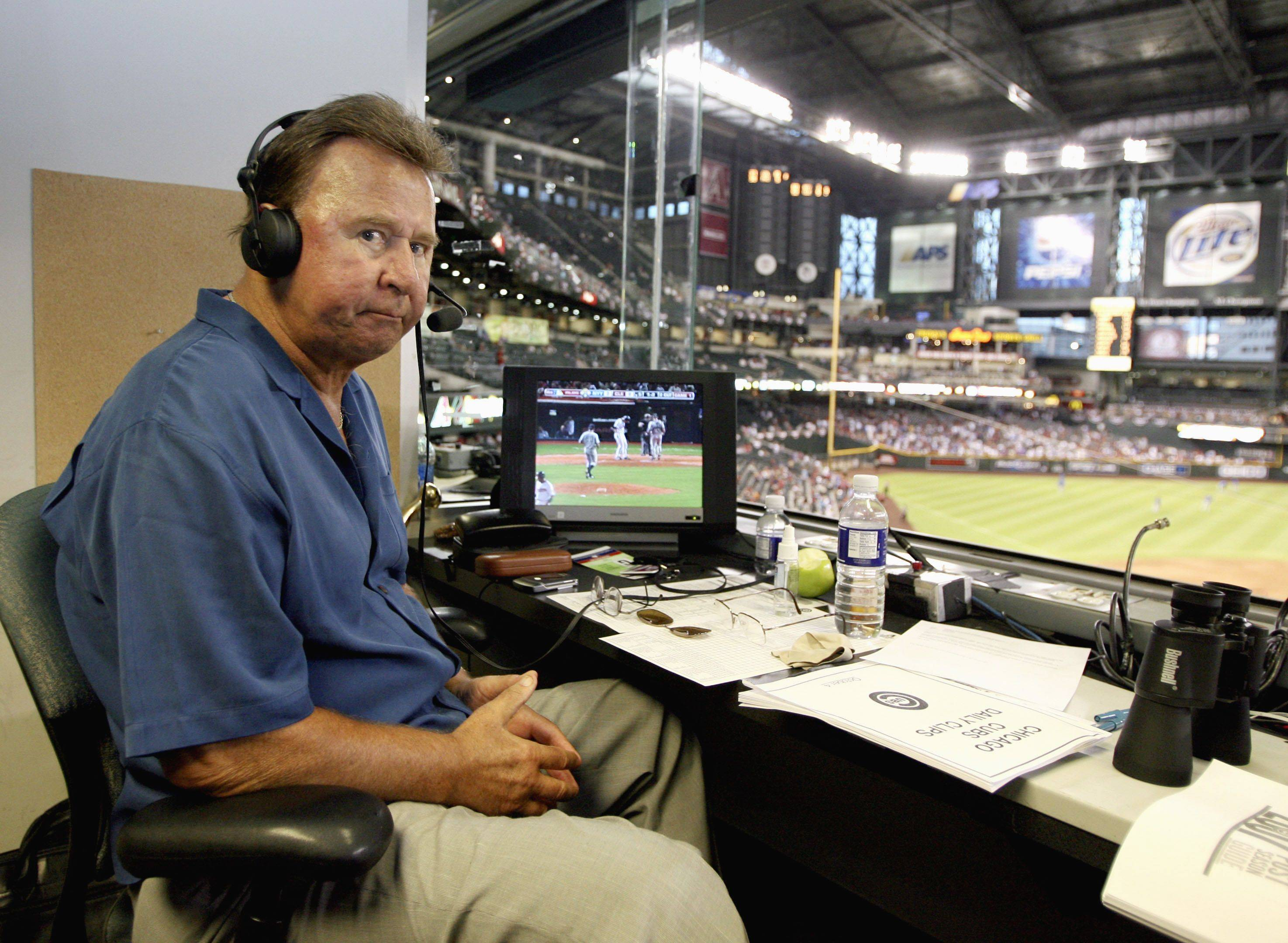 In this Oct. 4, 2007, file photo, former Chicago Cubs great and longtime radio announcer Ron Santo sits in the broadcast booth during a baseball game at Chase Field in Phoenix. .