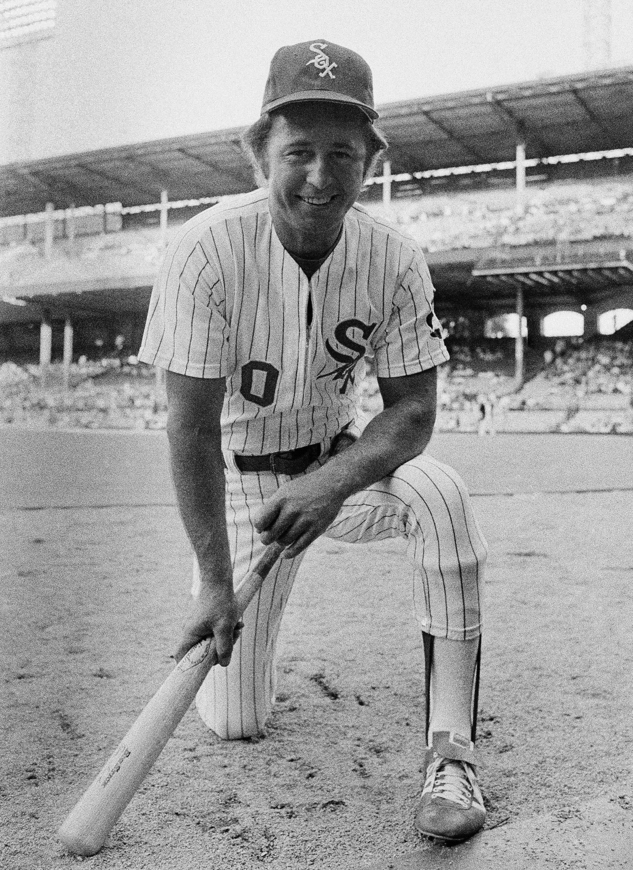 This July 3, 1974, file photo shows Chicago White Sox player Ron Santo kneeling before a game in Chicago.