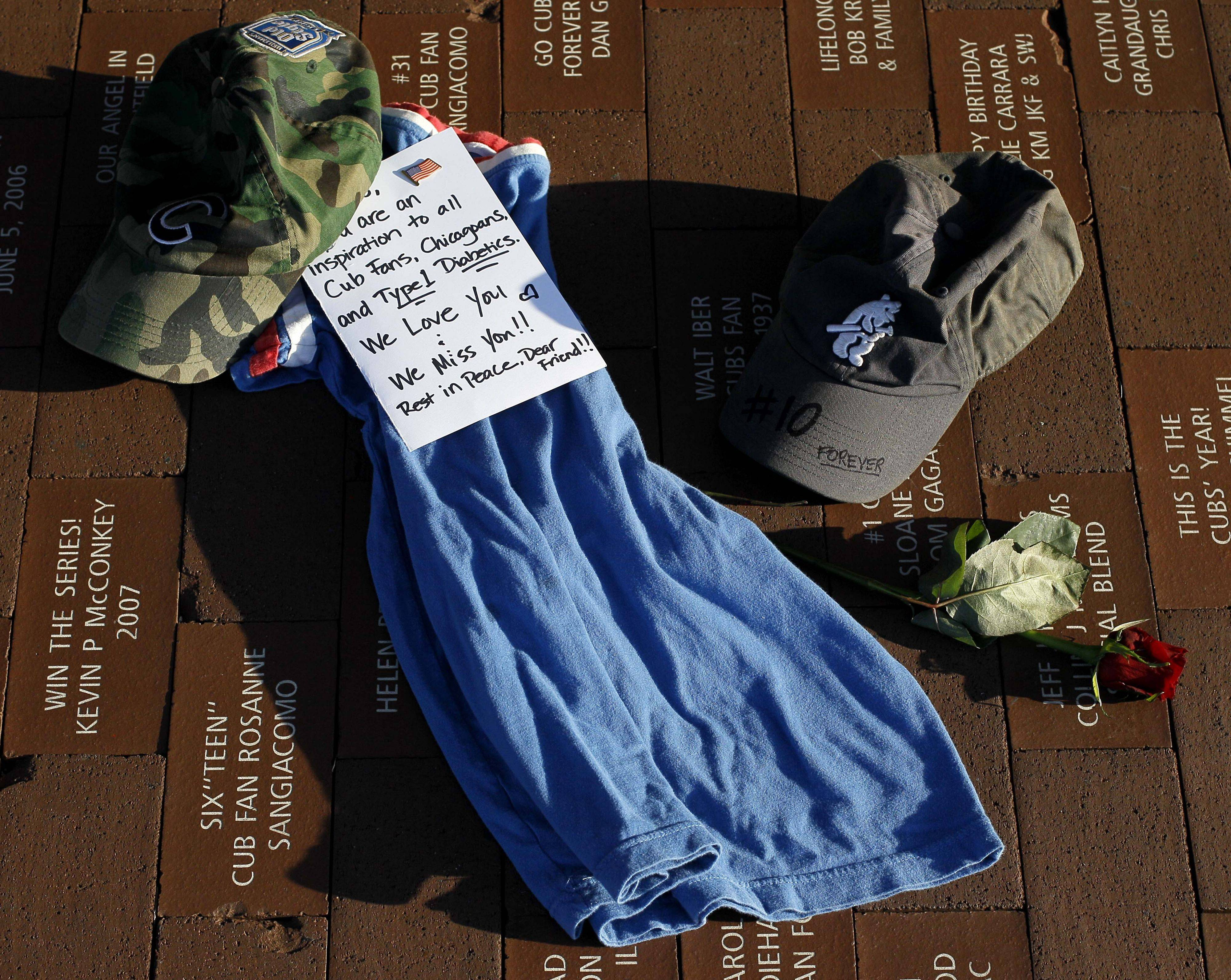 A memorial to former Chicago Cubs' Ron Santo, one of the greatest plays in Cubs history, is shown outside Wrigley Field after news of Santo's death was announced Friday.