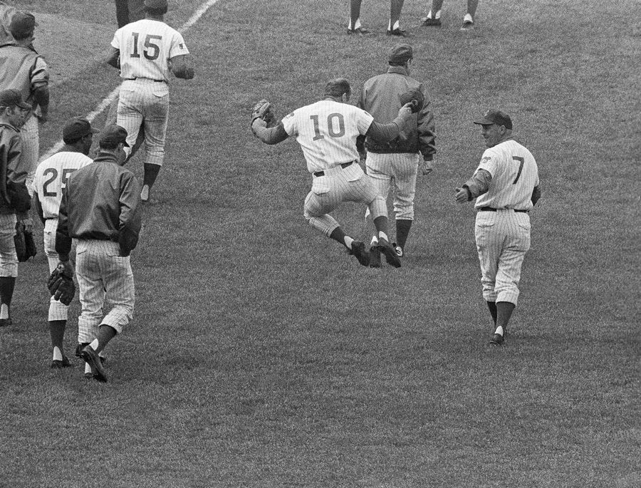 Ron Santo (10) clicks his heels all the way to the locker room after his ninth-inning sacrifice fly allowed the winning run to score for a 5-4 victory against Pittsburg, June 24, 1969.