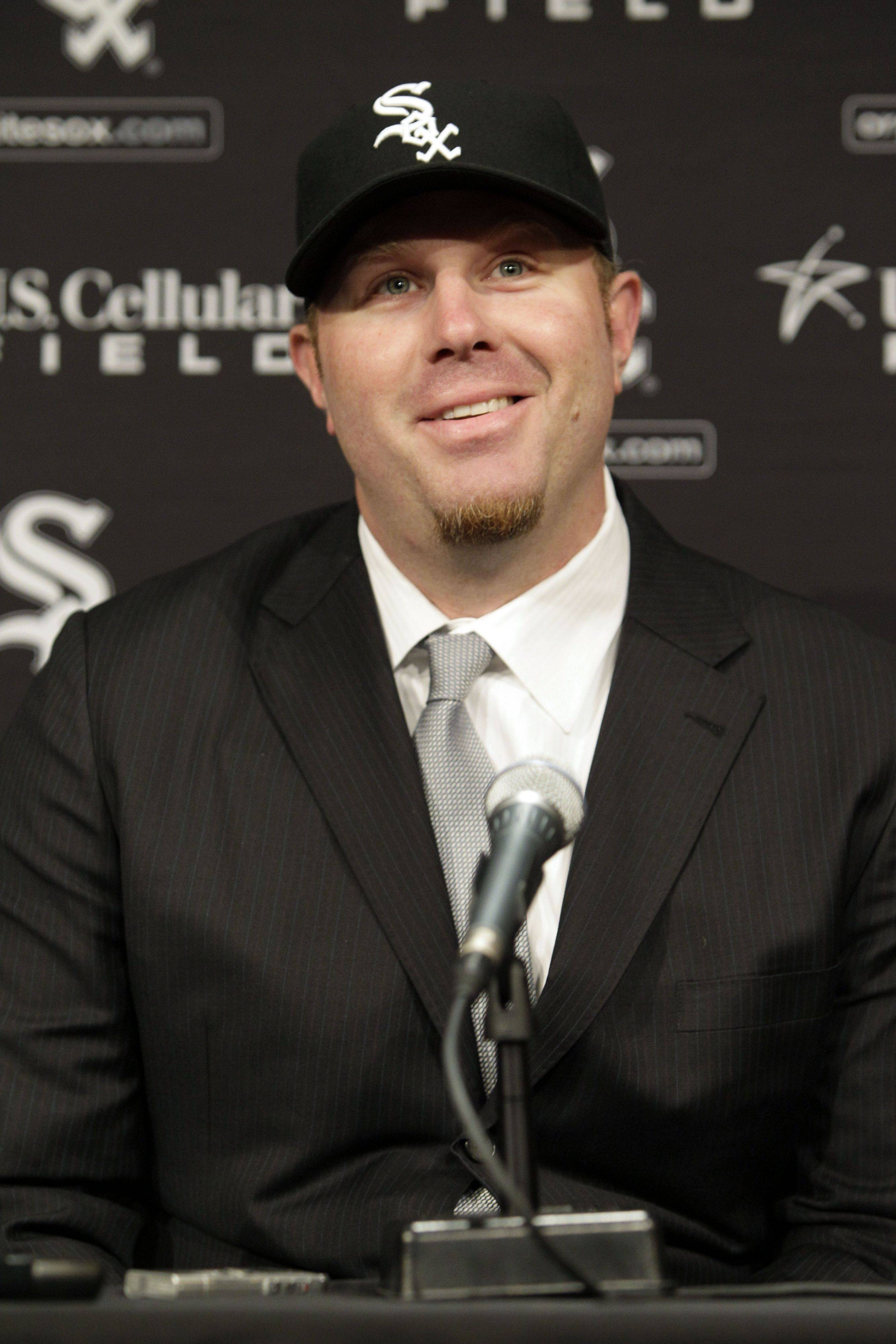 The White Sox's Adam Dunn listens to a question during a news conference in Chicago on Friday. Dunn agreed to a four-year deal worth $56 million with the White Sox.