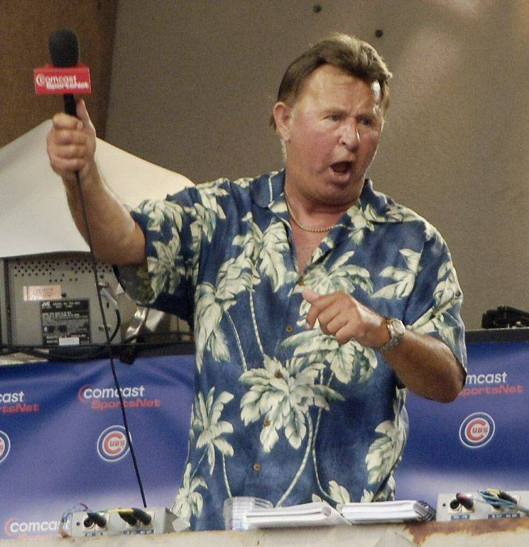 "Ron Santo leads the crowd in singing ""Take Me Out to the Ball Game"" during the seventh inning stretch of a game at Wrigley Field in 2006."