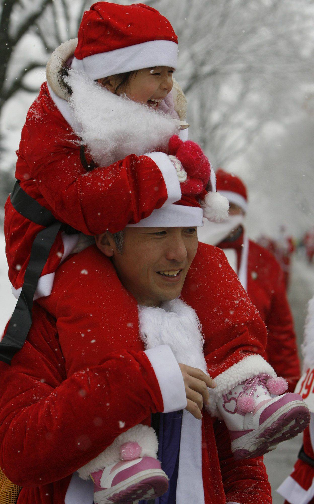Over 1,000 runners braved the first snow of the season to participate in the Santa Sleigh 5K run in Arlington Heights on Saturday.