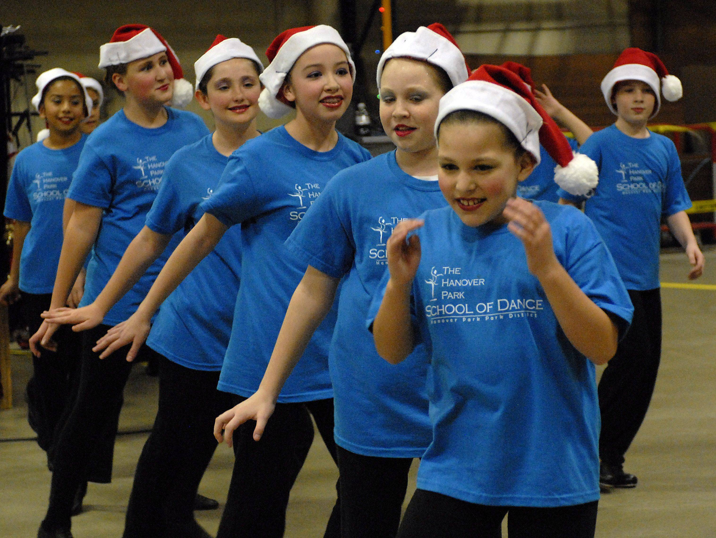 Part of the entertainment at the fifth-annual tree lighting ceremony in Hanover Park, Sophia Alvarado, 7, in front dances with the rest of the Hanover Park School of Dance bringing smiles and good cheer to all who attended the gala event.