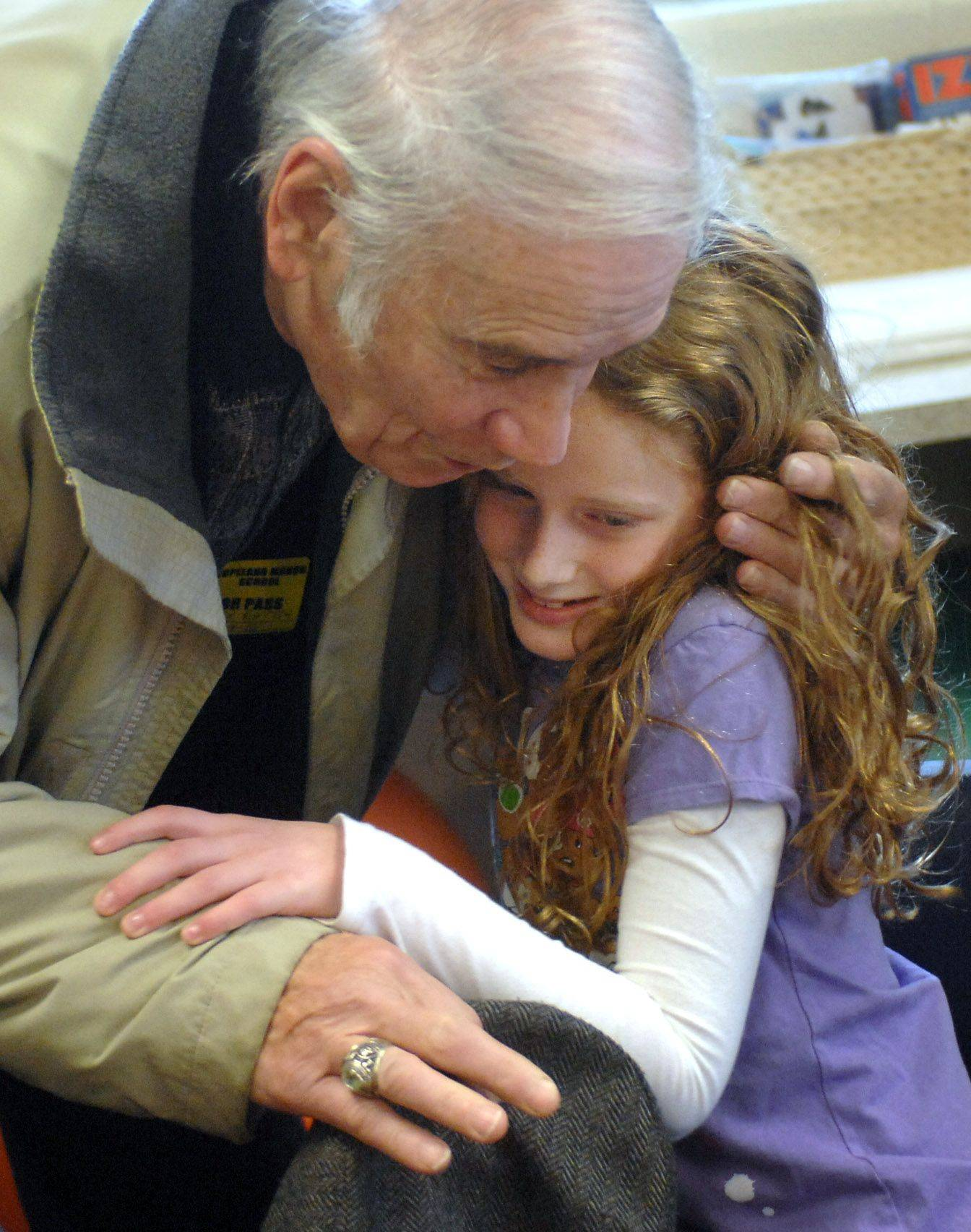 Third-grade students at Copeland Manor School in Libertyville held a Grandparents Day event Monday. Student Maeve Rattin gets a hug from her grandfather Tony Rattin of Libertyville. The event included an activity comparing school from when the grandparents were in school to now.