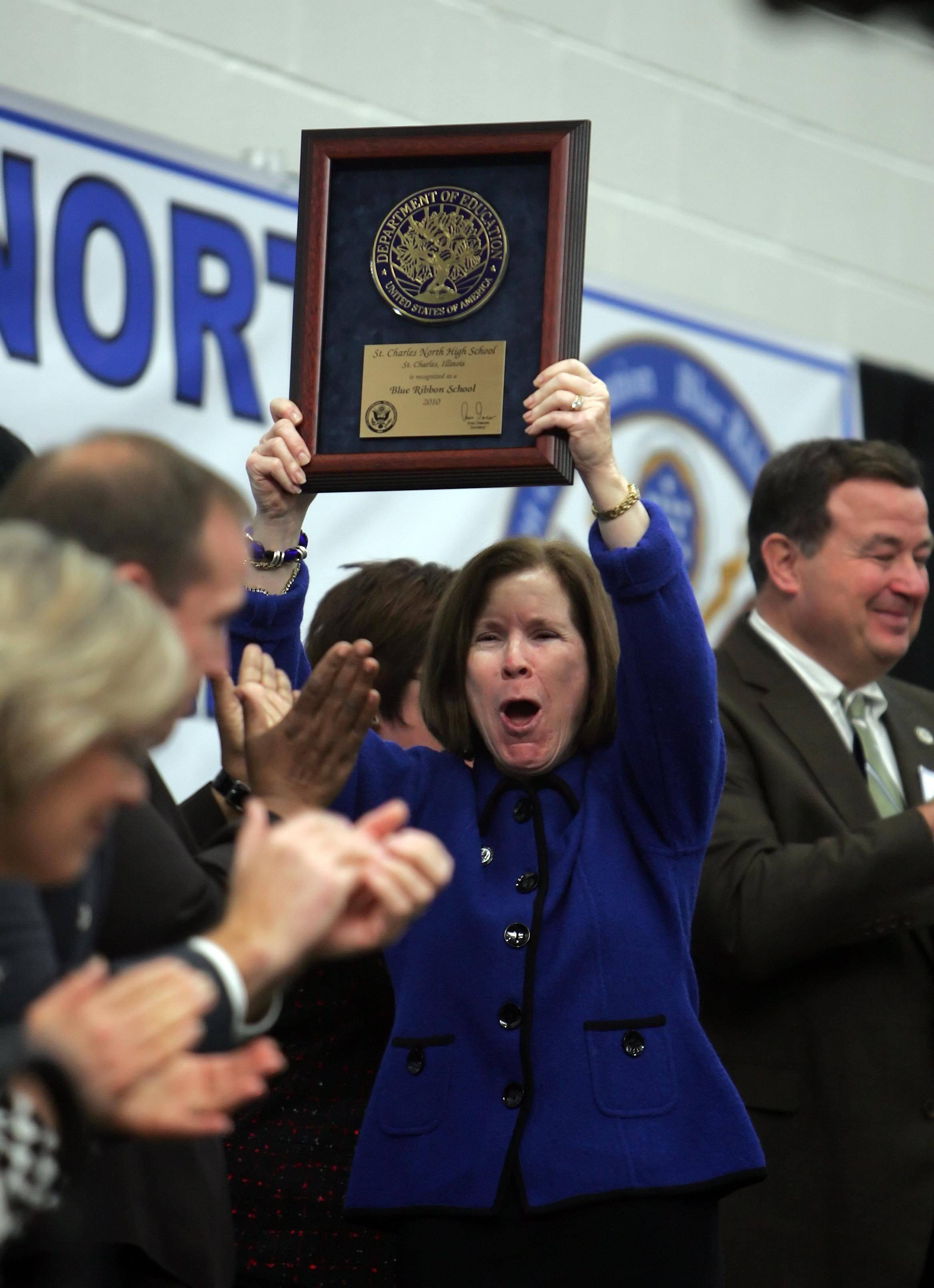 Biology teacher Janice Young holds up the plaque that St. Charles North High School received for the prestigious Blue Ribbon Award Thursday, December 2.