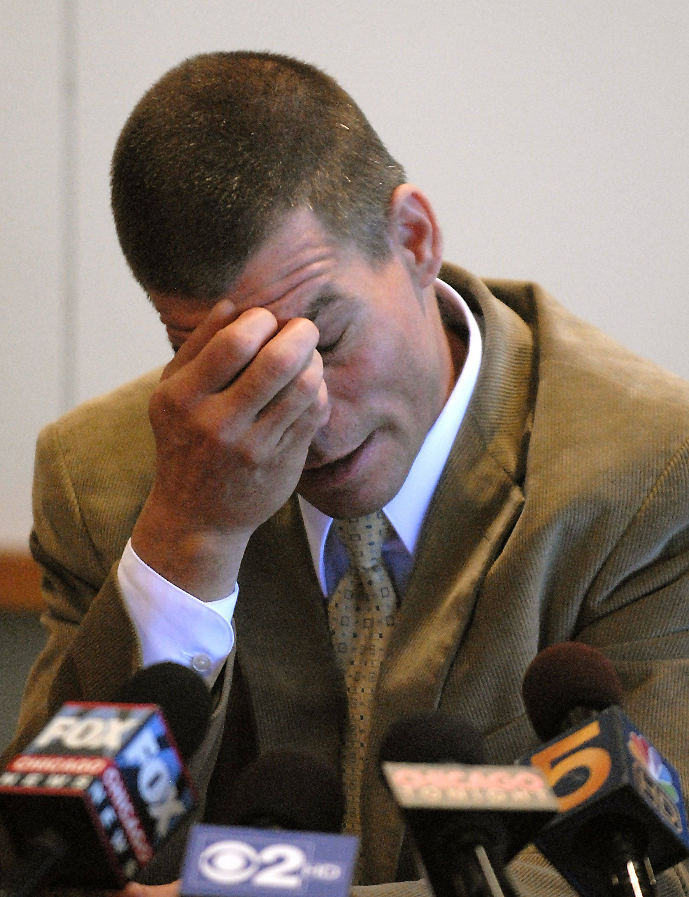 Jerry Hobbs, a former Zion resident who spent five years in jail for the murder of his daughter and another girl, becomes emotional as he is asked about the forced confession he gave during a press conference at Northwestern School of Law in Chicago.