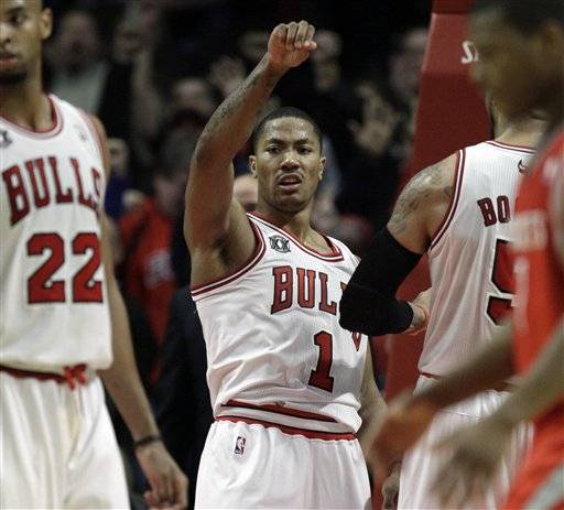 Derrick Rose celebrates after the Bulls defeated the Houston Rockets 119-116 in overtime in Chicago Saturday.