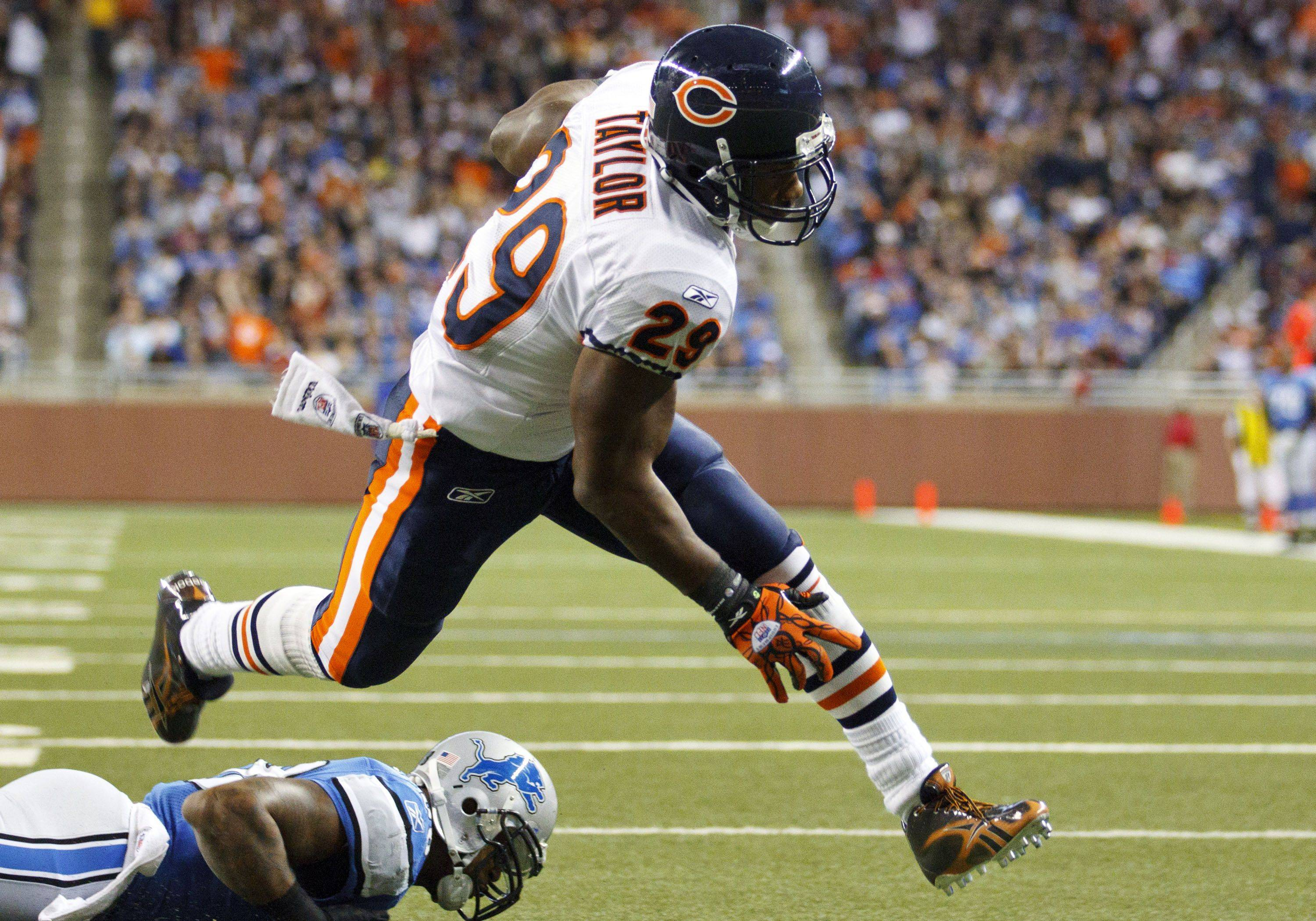 Chicago Bears running back Chester Taylor runs the ball in for a touchdown in the first half.