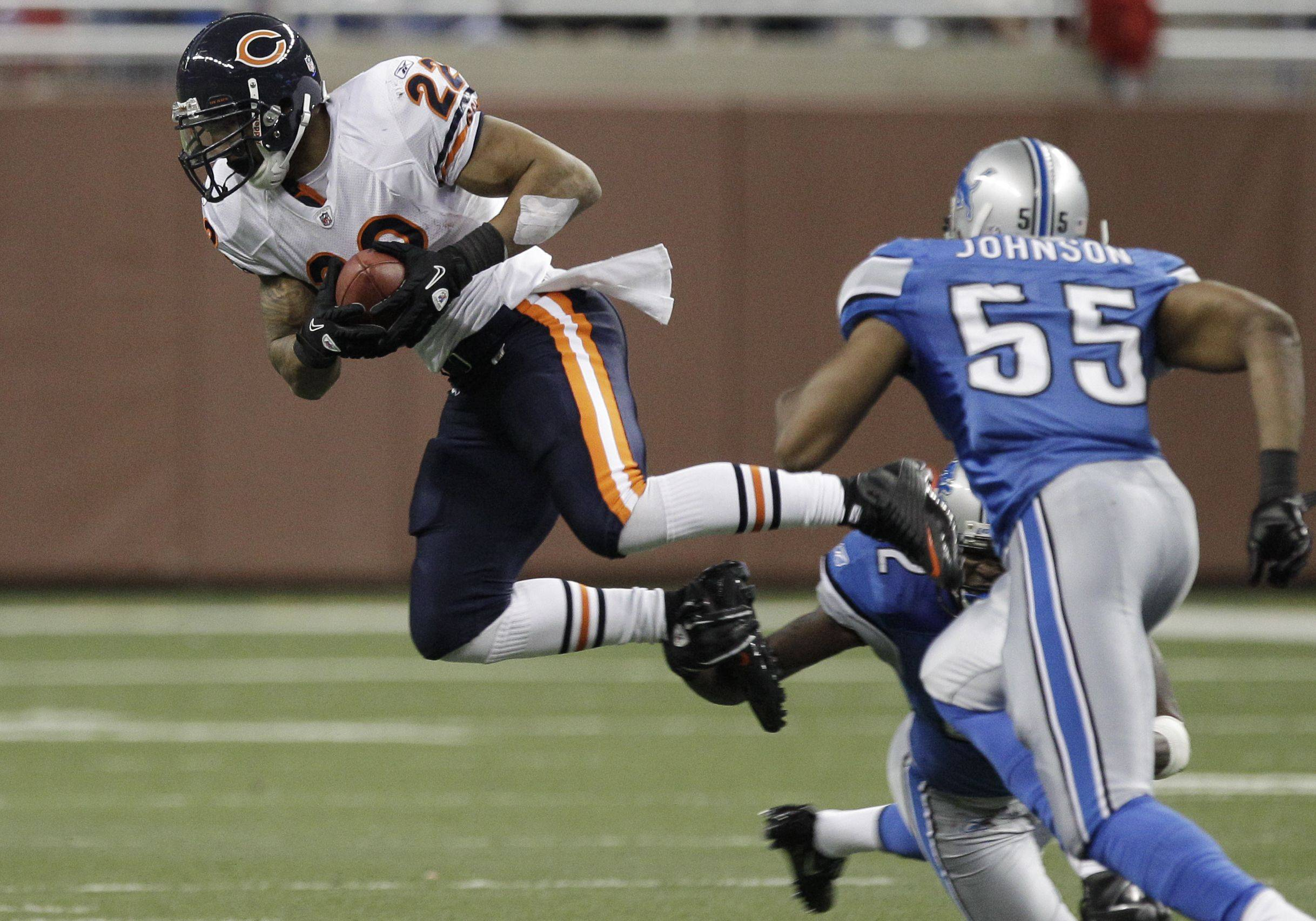 Chicago Bears running back Matt Forte is tripped up on a reception against the Detroit Lions in the fourth quarter. Chicago won 24-20.