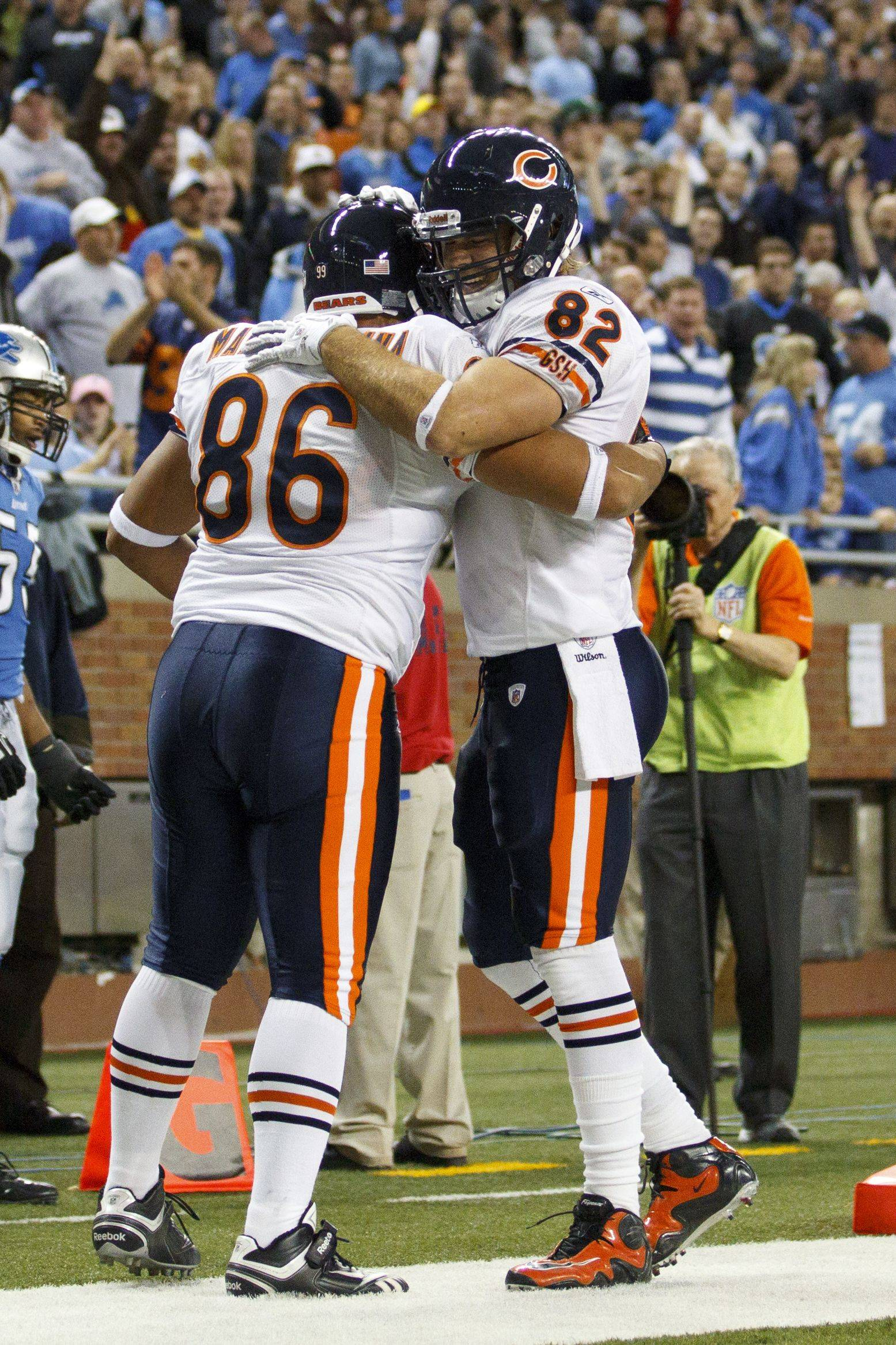 Bears tight end Brandon Manumaleuna and tight end Greg Olsen celebrate Manumaleuna game winning touchdown in the second half.