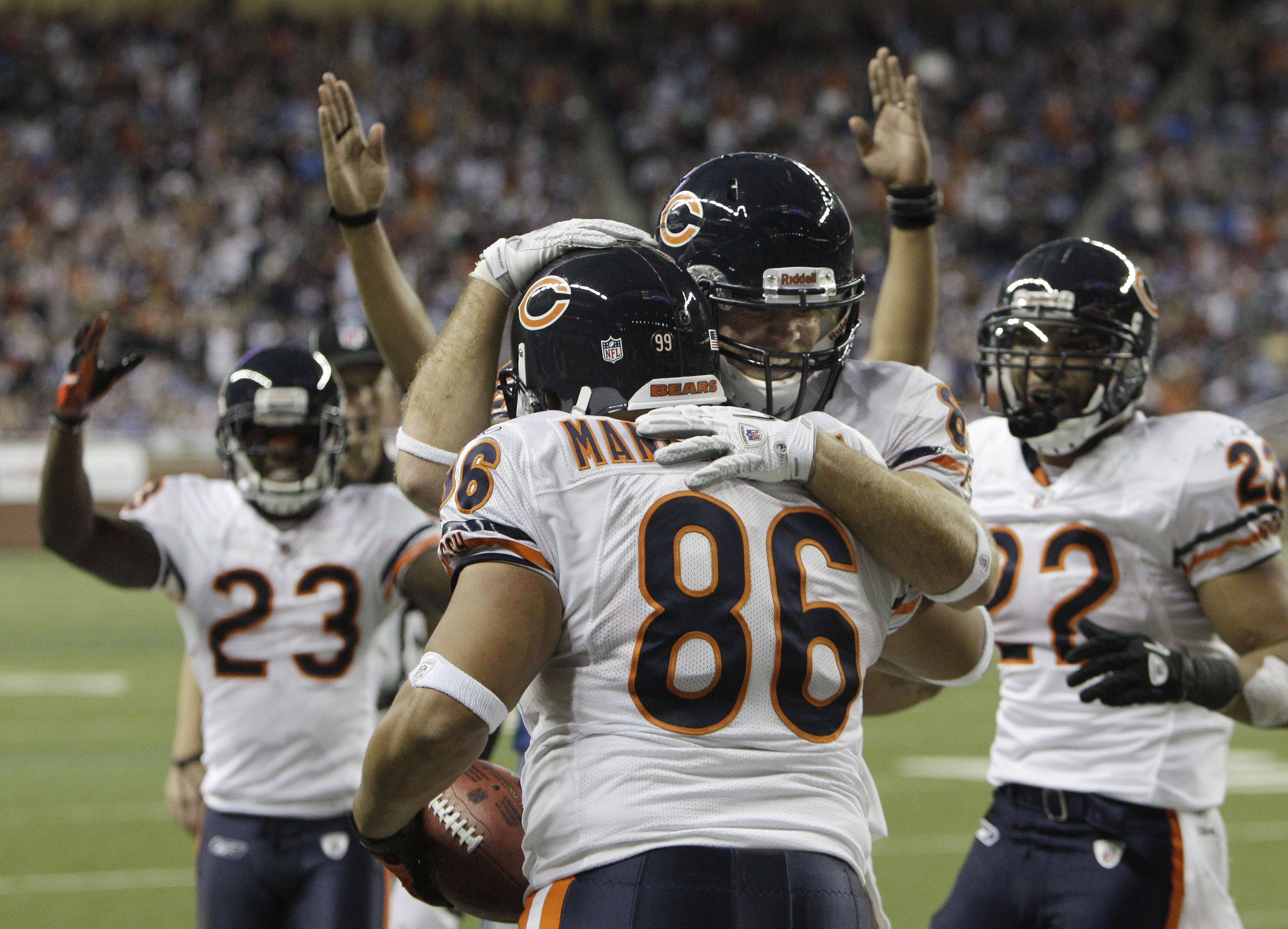 Chicago Bears tight end Brandon Manumaleuna is congratulated by teammates after his touchdown in the fourth quarter.