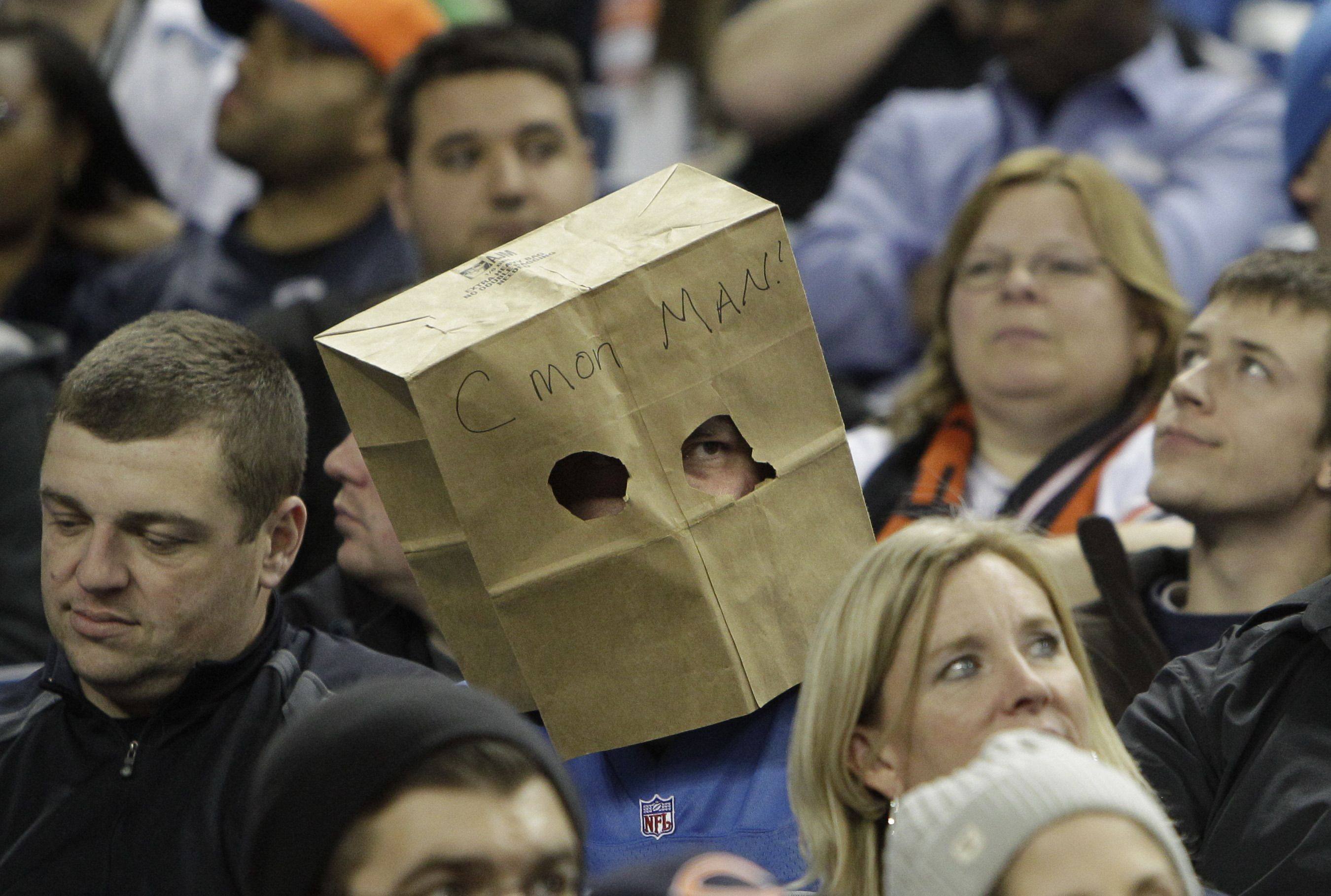 A Detroit Lions fan wears a bag during the fourth quarter.