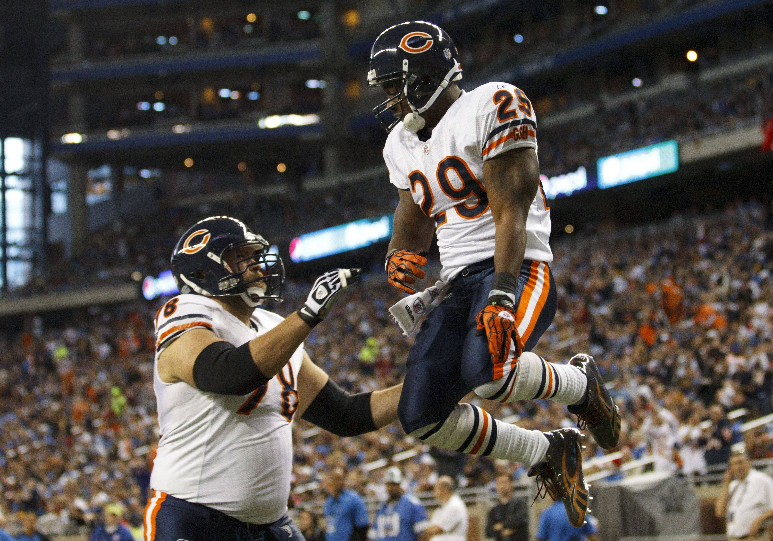 Chicago Bears running back Chester Taylor celebrates his touchdown with Chicago Bears offensive tackle Kevin Shaffer in the first half.