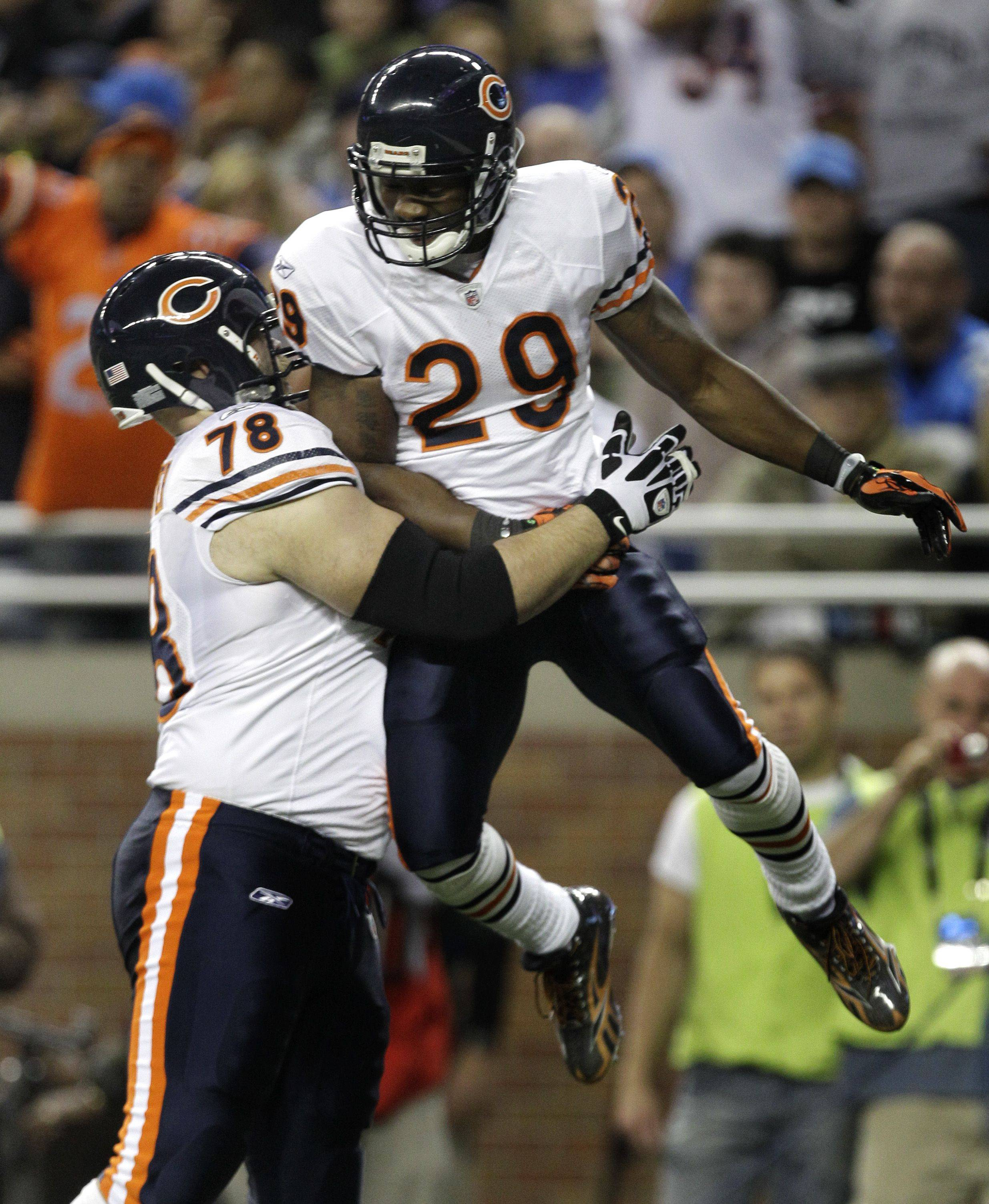 Chicago Bears running back Chester Taylor celebrates his 1-yard touchdown run with offensive tackle Kevin Shaffer in the first quarter.