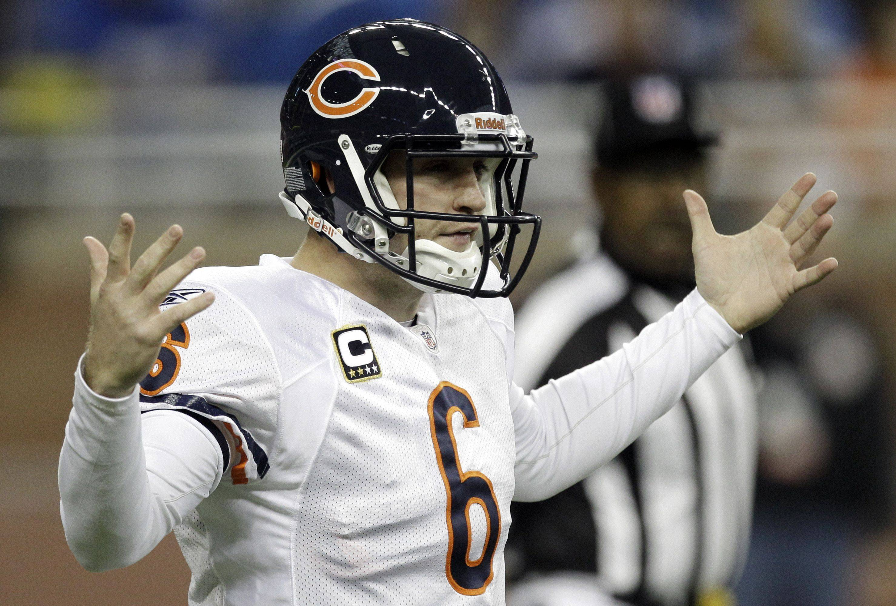 Chicago Bears quarterback Jay Cutler reacts to waiting for a play to be sent from the sidelines against the Detroit Lions in the first quarter.