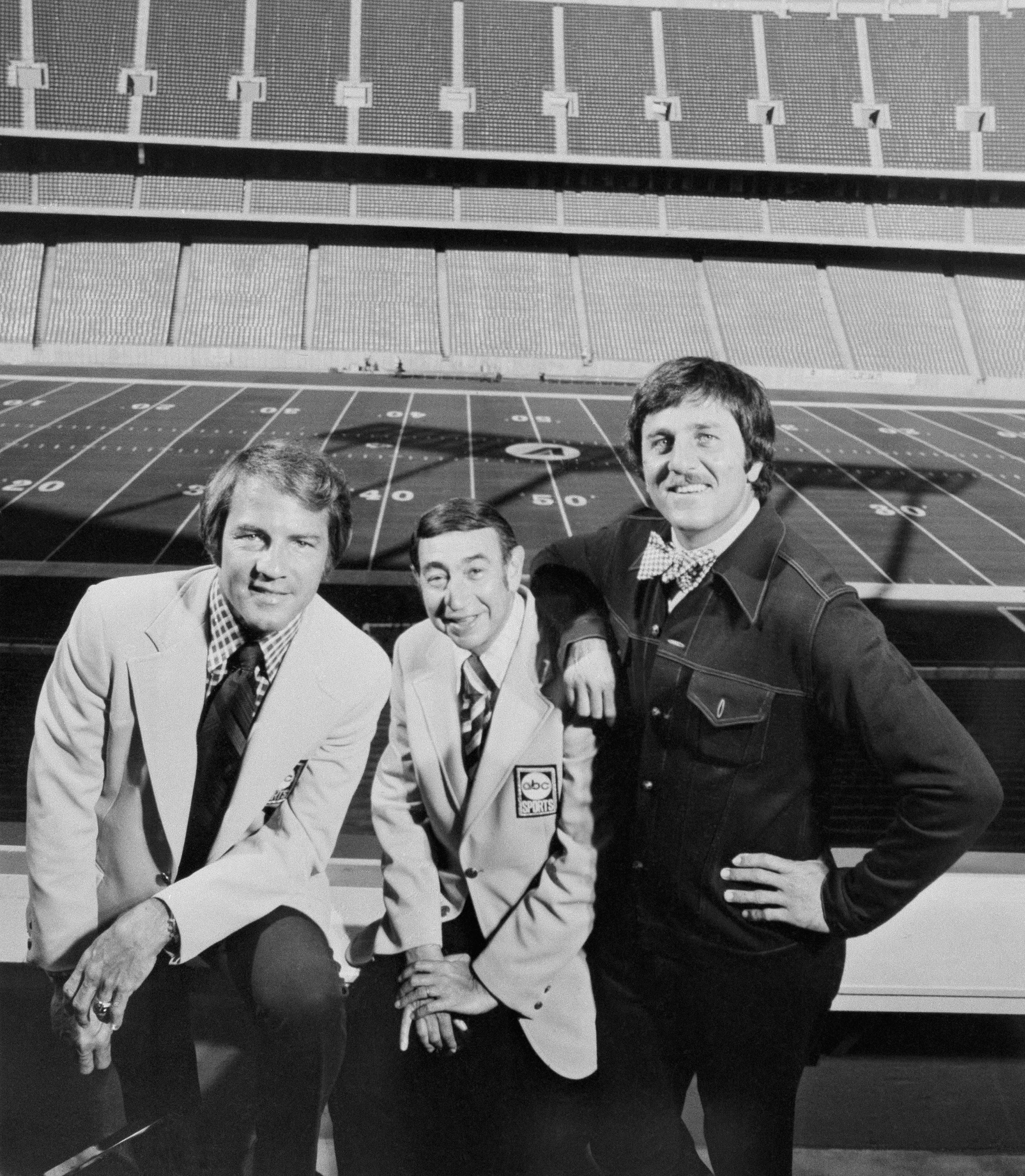 This Nov. 20, 1973, photo provided by ABC-TV shows, from left, Frank Gifford, Howard Cosell and Don Meredith.