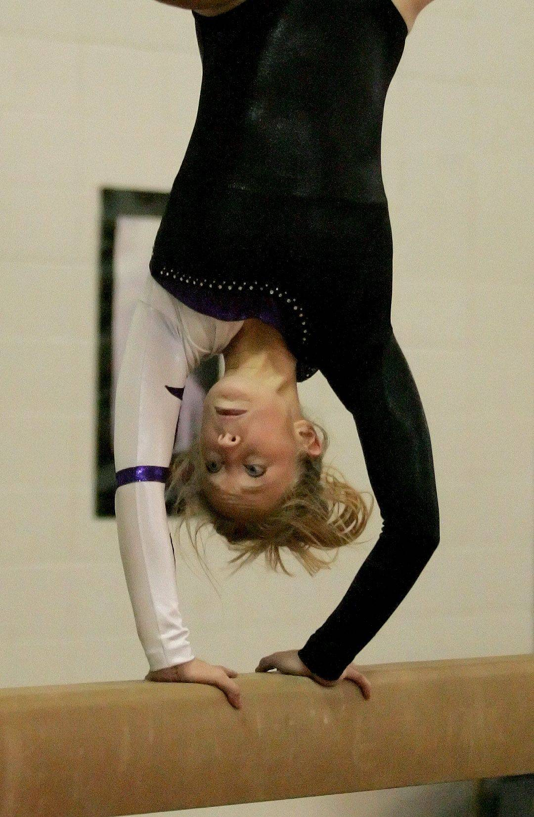 Emily Cook of Wheaton Warrenville South Co-op performs her beam routine during the gymnastics meet in Wheaton on Monday.