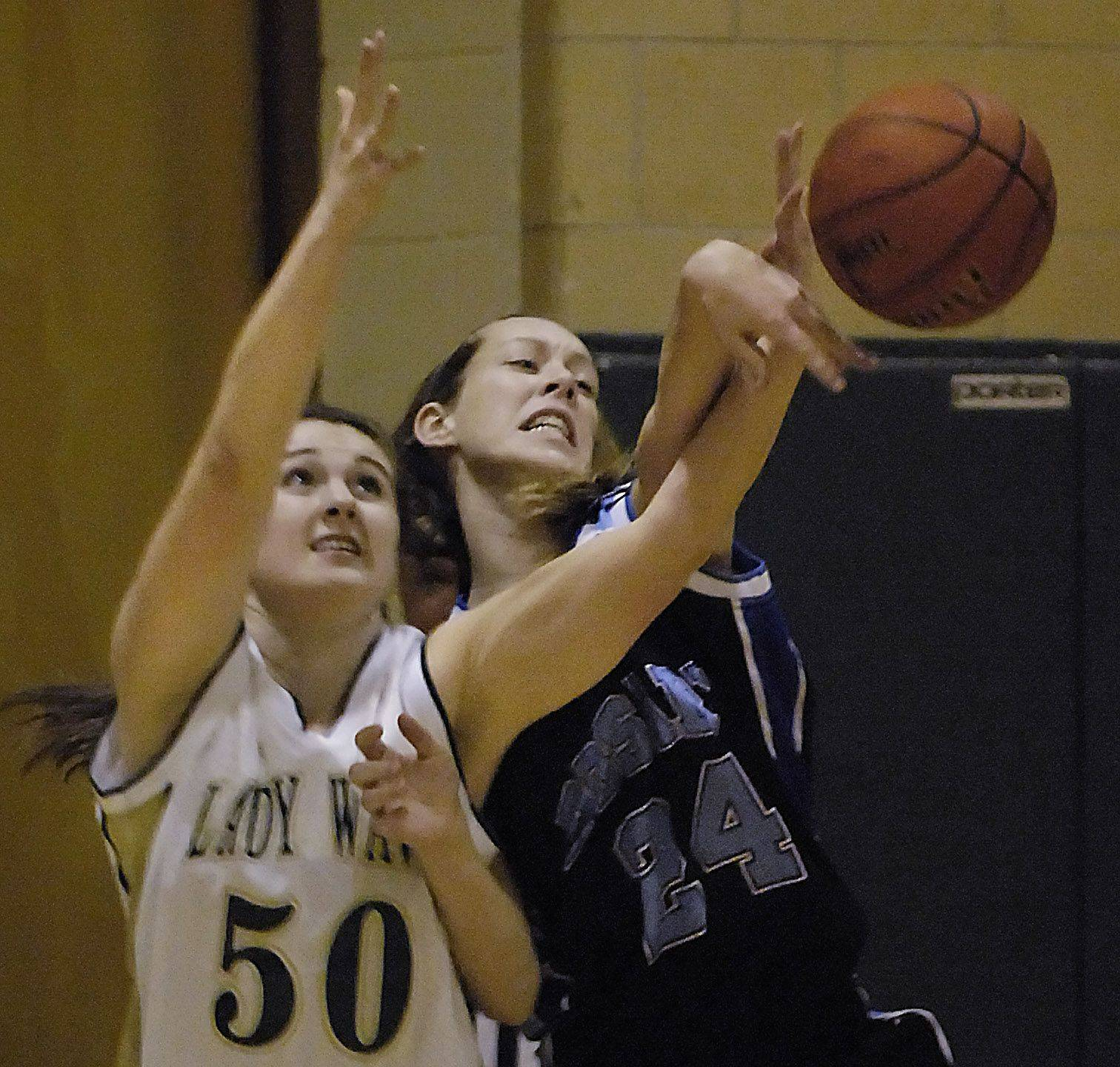 Rosary's Maddie Kombrink keeps the ball away from St. Edward's Alexandria Lee Thursday in Elgin.