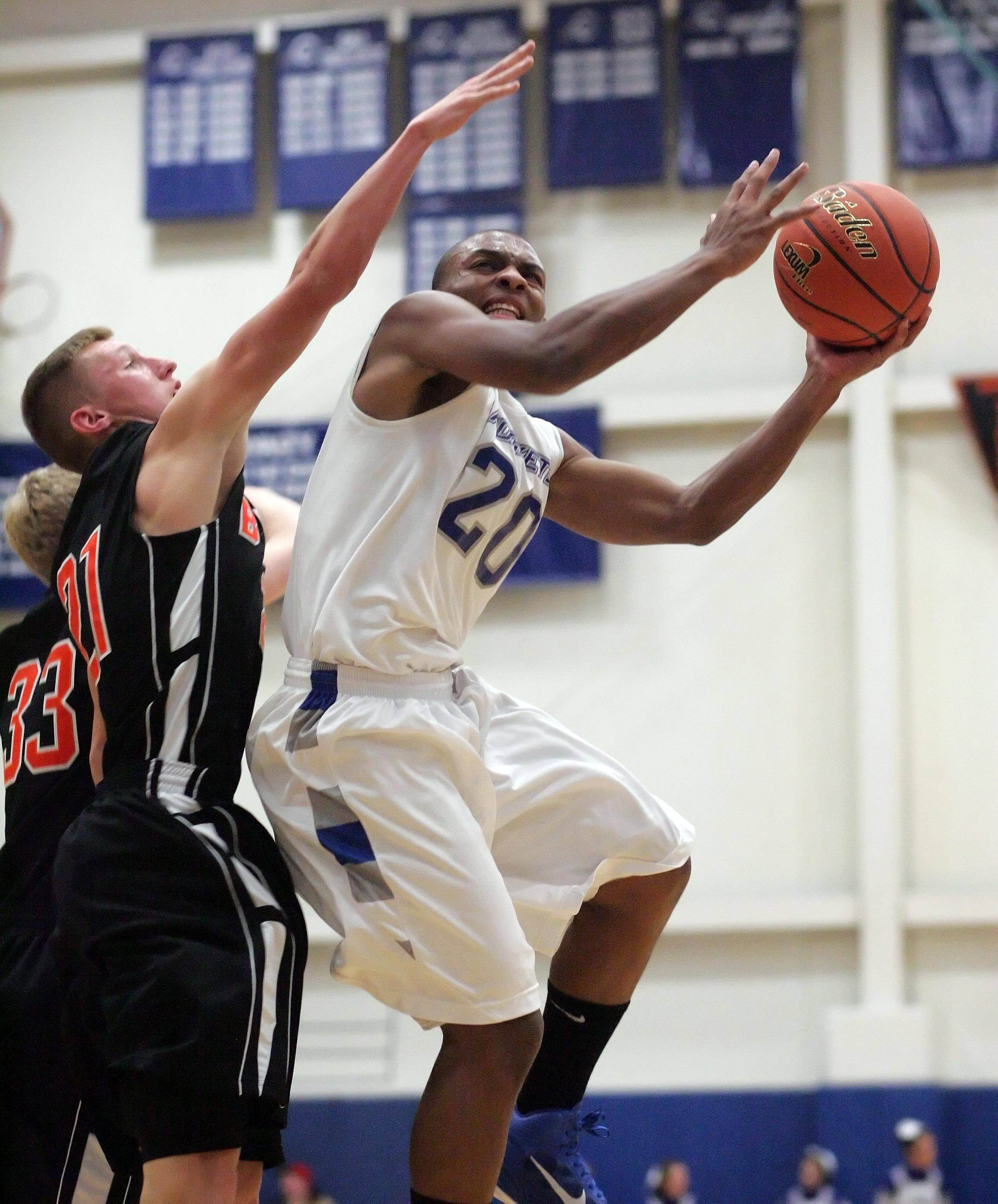 Burlington Central's Ray Hunnicutt, 20, heads to the hoop against Byron's defense Friday at Burlington Central.