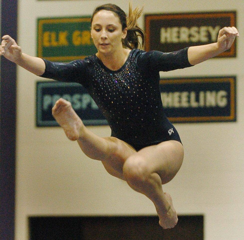Christina Pekar of Prospect on the balance beam at the Rolling Meadows girls gymnastics meet Saturday.