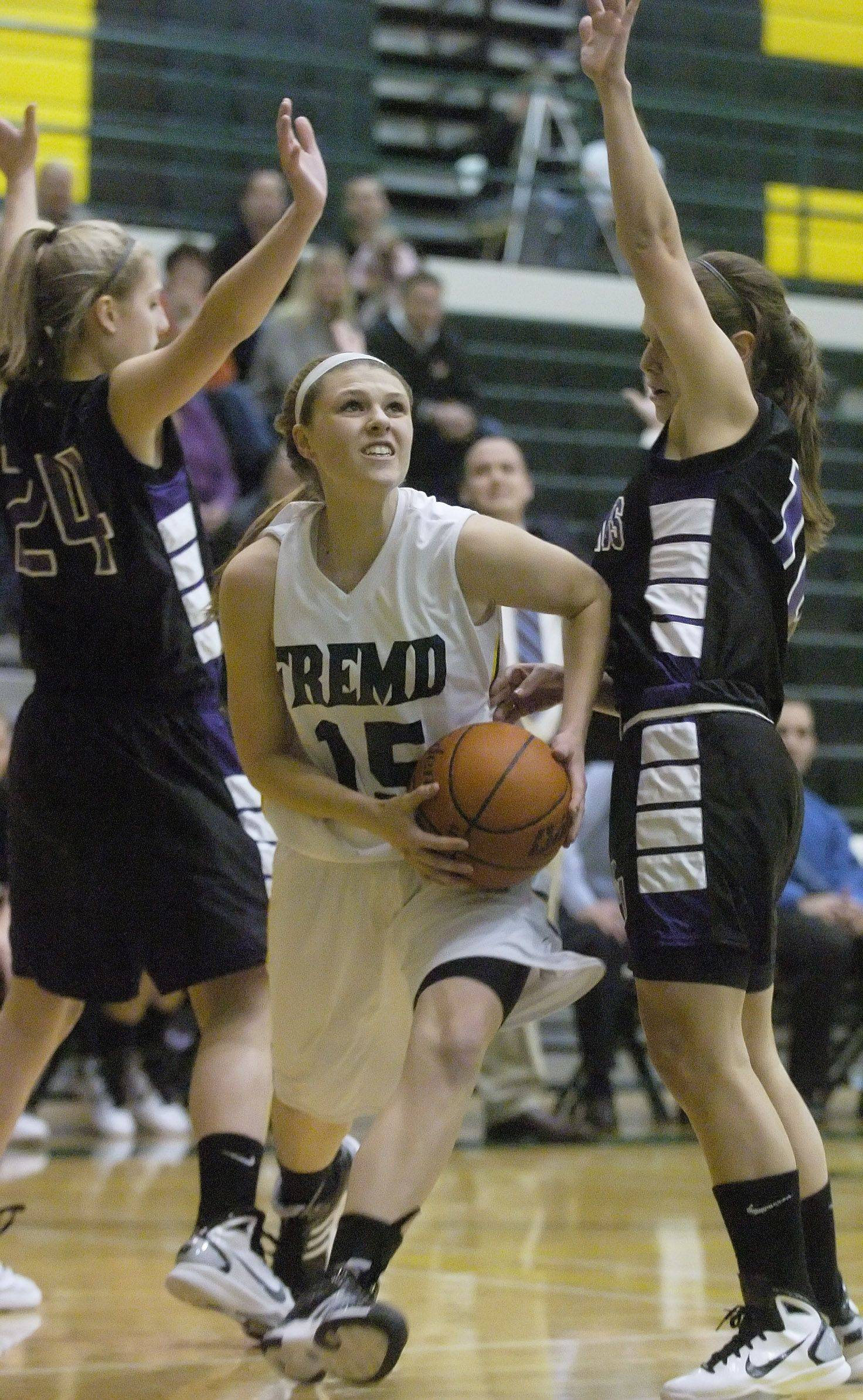 Jaimie Groot of Fremd, middle, steps between Alexis Glasgow, left, and Madelynn Conlin of Rolling Meadows Tuesday.