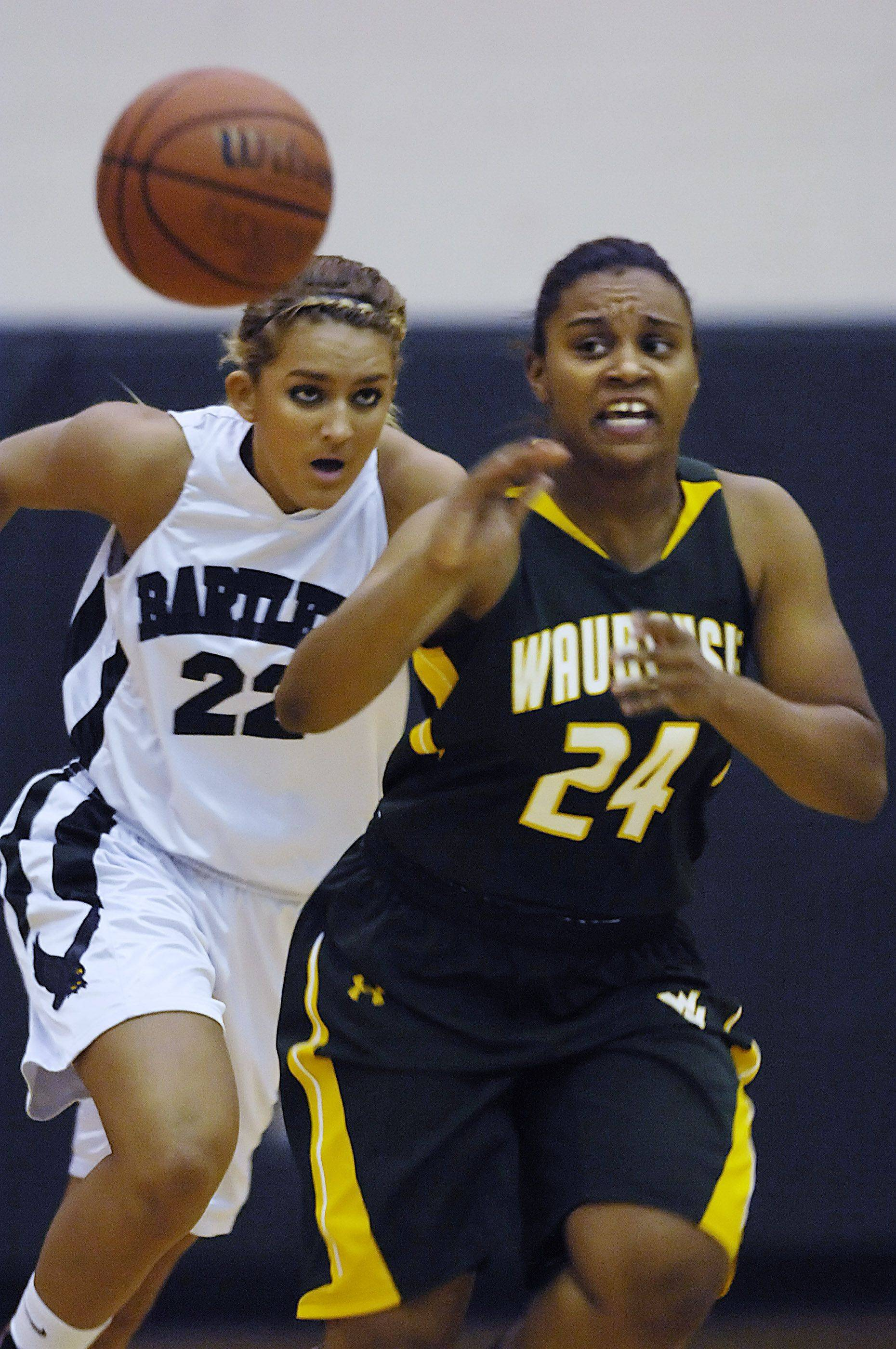 Waubonsie Valley's Tanysha Gardner-Walls passes the ball as Bartlett's Haley Videckis chases Tuesday.
