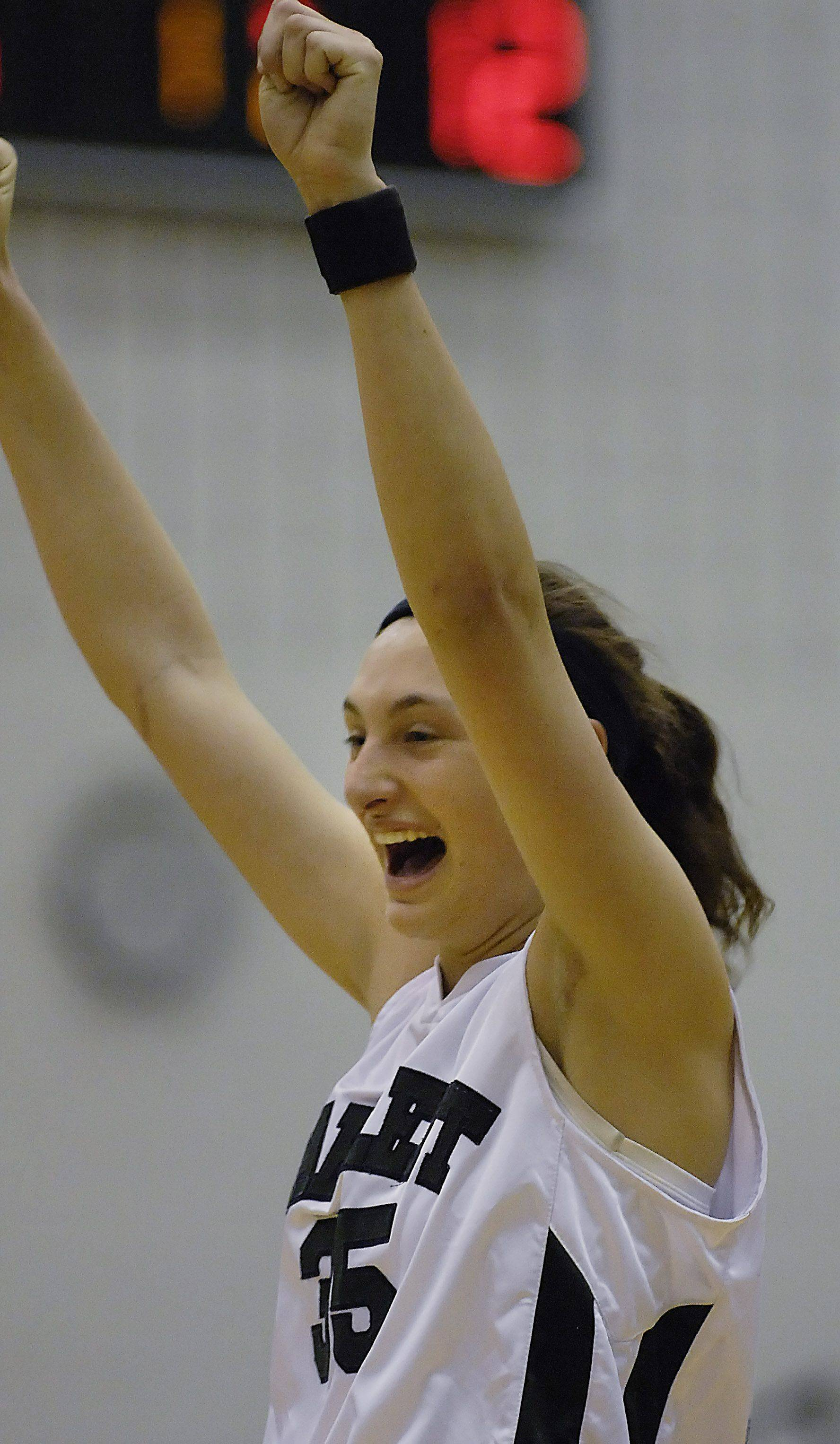 Bartlett's Jacki Gulczynski celebrates a buzzer-beating basket by teammate Nicole Beck against Waubonsie Valley Tuesday.