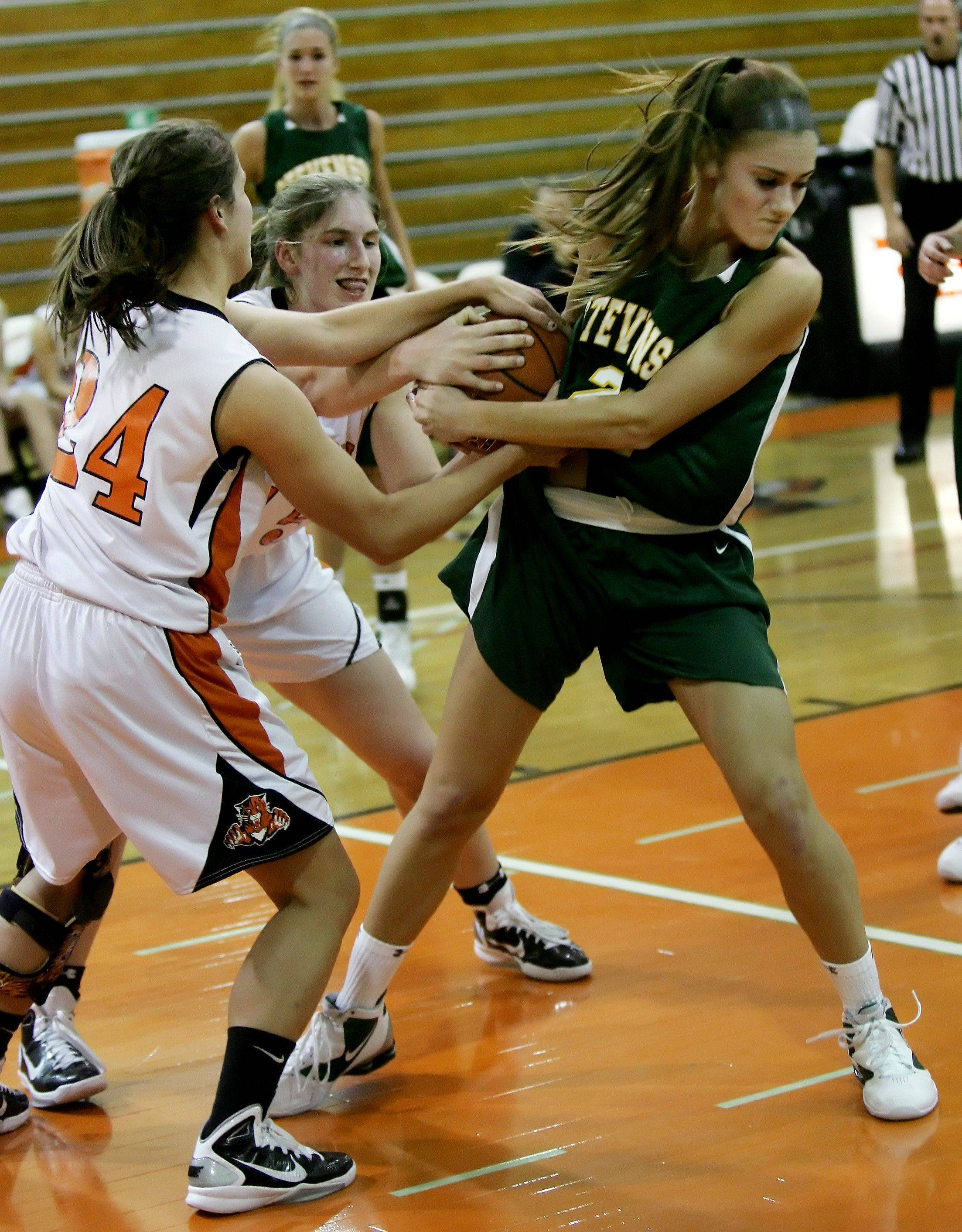 Libertyville's Kaca Savatic and Nicole Kruckman battle Stevenson player Ashley Niedermayer for a rebound during the girls basketball game Tuesday in Libertyville.