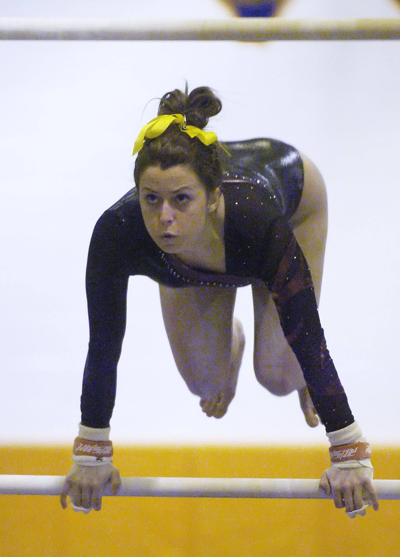 Schaumburg's Caitlin Barrett competes on the uneven parallel bars during Wednesday's gymnastics meet at Buffalo Grove.
