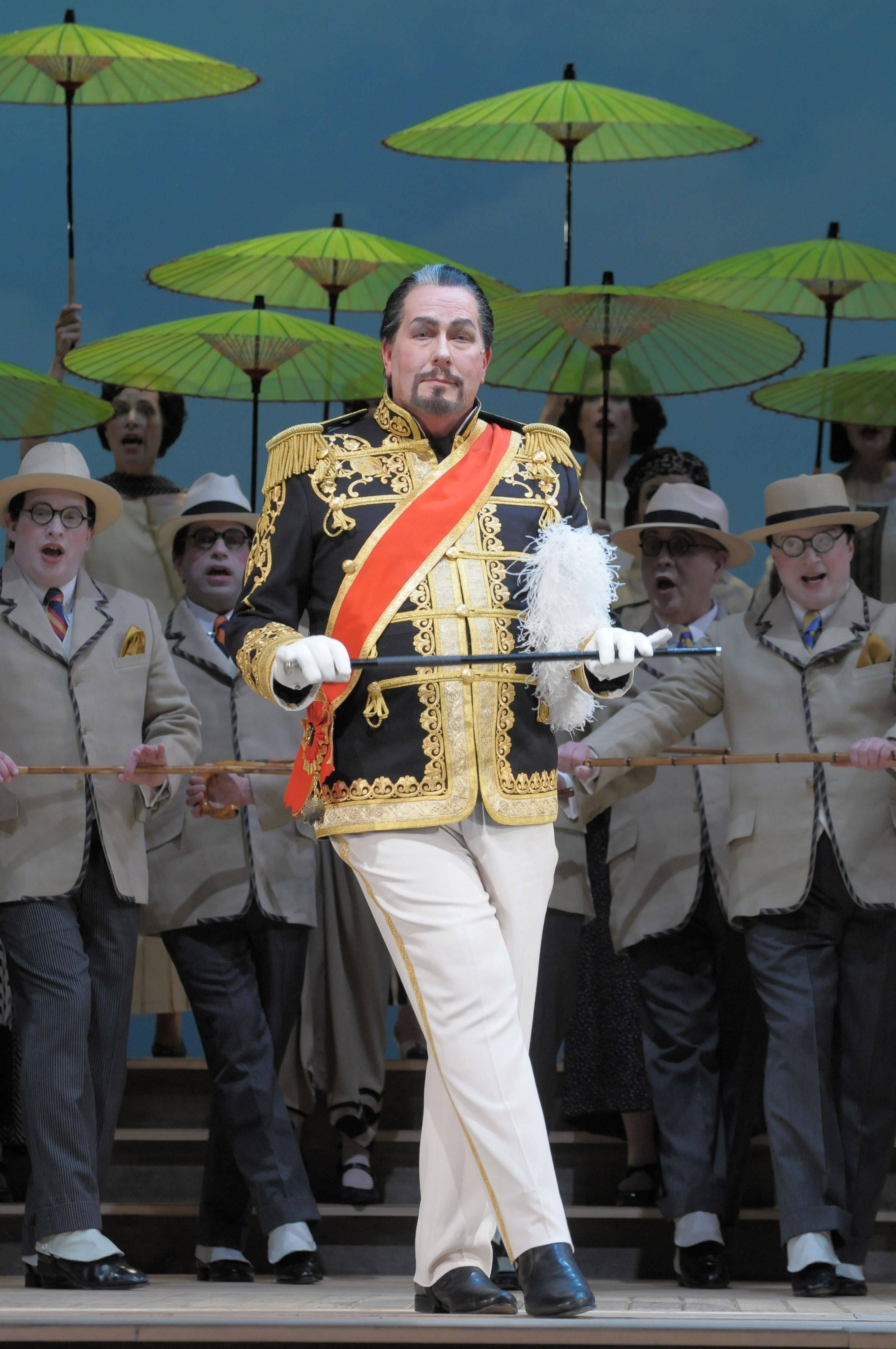 "The Emperor of Japan (James Morris) explains his prosecution philosophy to ""Let the Punishment Fit the Crime"" in the Lyric Opera of Chicago's new production of Gilbert and Sullivan's 1885 comic operetta ""The Mikado."""