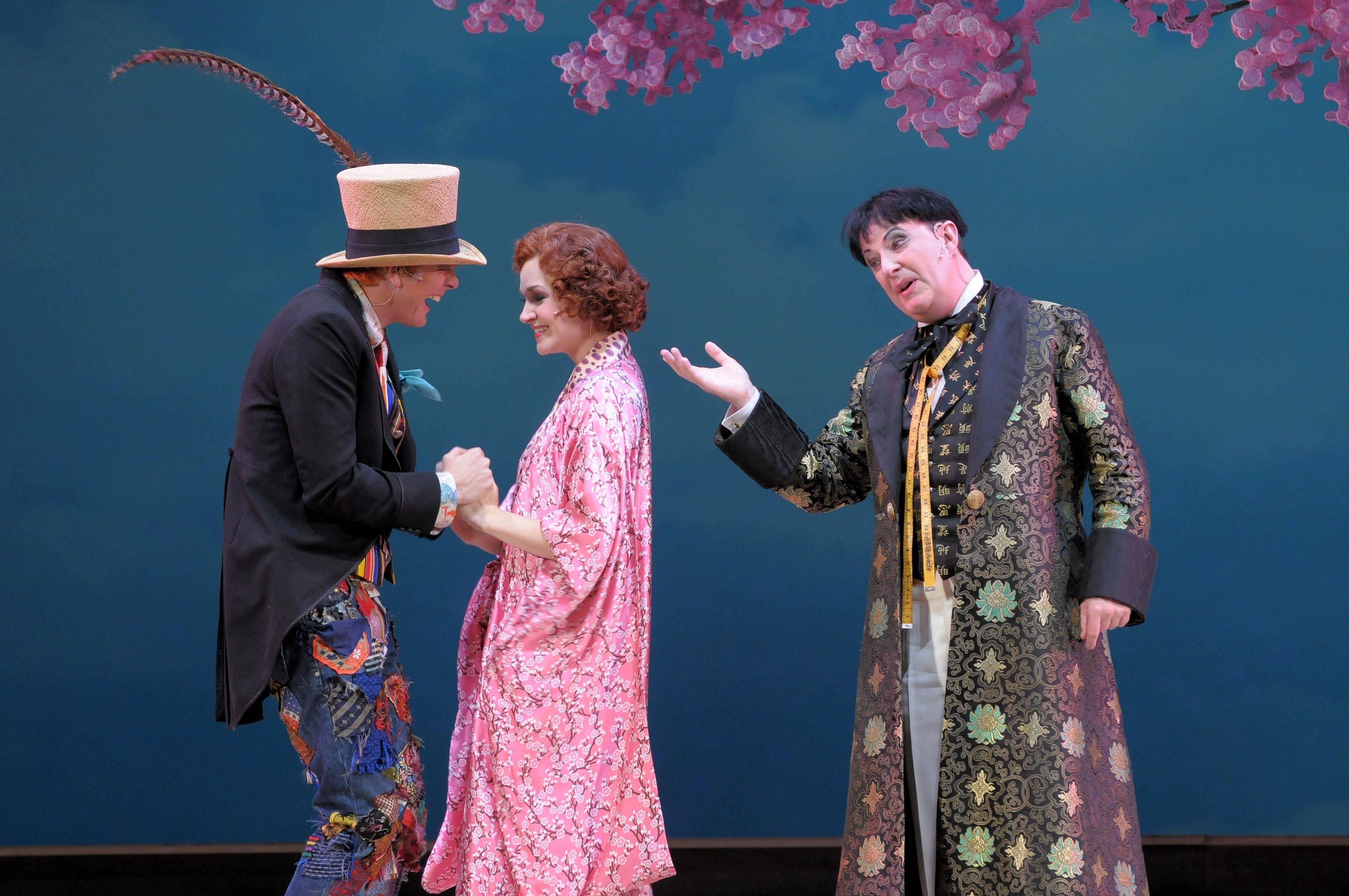 "Nanki-Poo (Toby Spence) and Yum-Yum (Andriana Chuchman) are about to get some bad news from Ko-Ko (Neal Davies) in the Lyric Opera of Chicago's new production of Gilbert and Sullivan's ""The Mikado."""