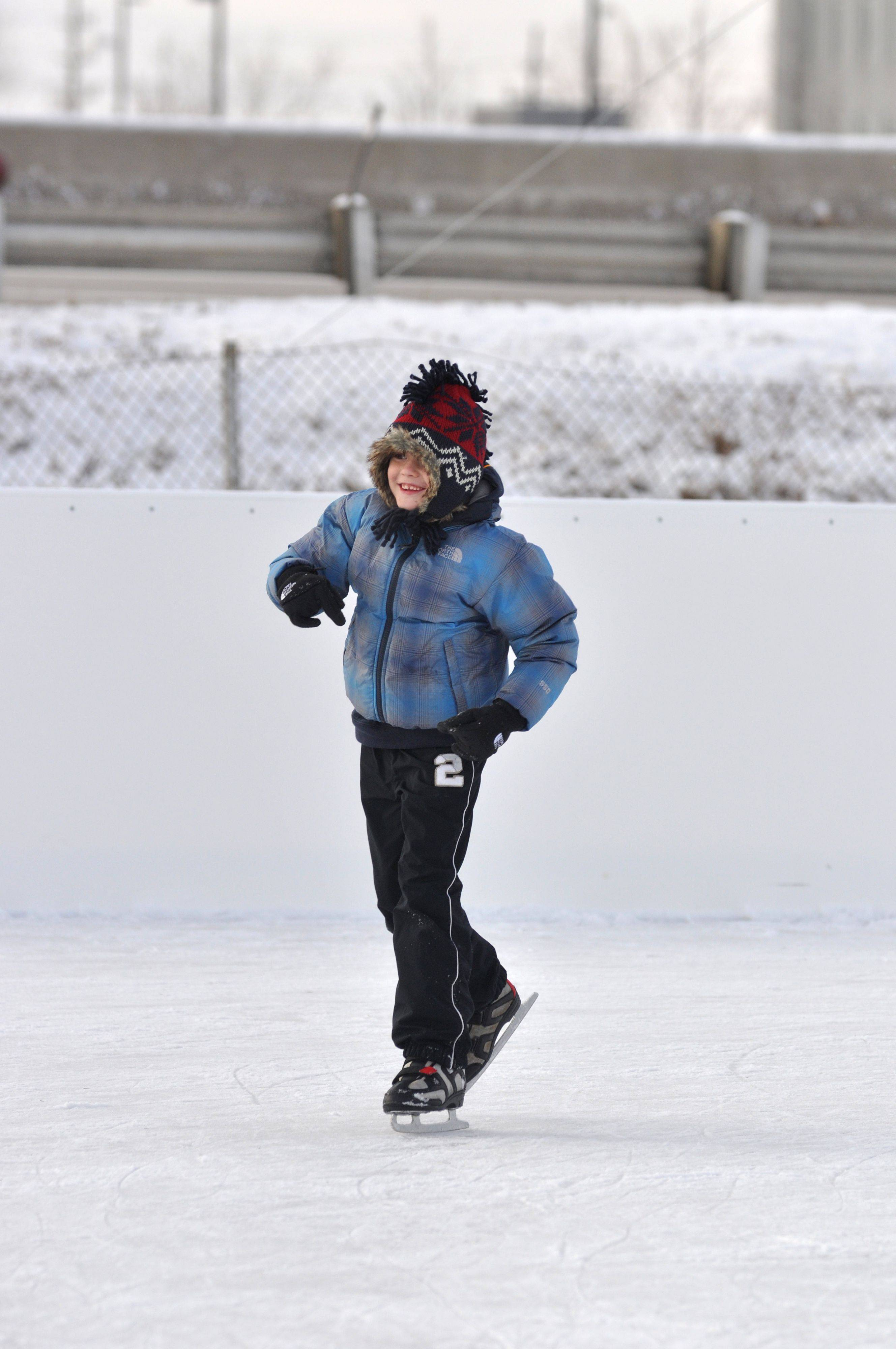 Patrick Mojsa, 7, of Norridge, smiles as he skates away from the help of his father, Marek Mojsa, at the new outdoor skating rink in Rosemont.