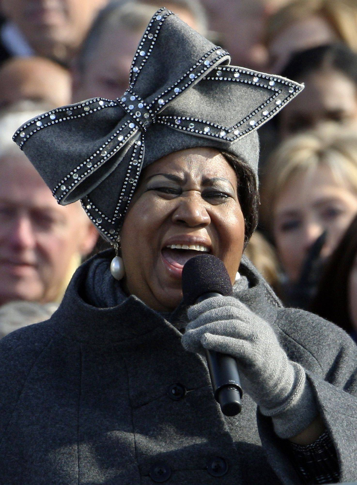 "In this Jan. 20, 2009 file photo, Aretha Franklin wears a gray felt custom-designed hat as she performs at the inauguration ceremony for President Barack Obama at the U.S. Capitol in Washington. Franklin says it would be hard to part with the hat since the day was ""a crowning moment in history,"" but will consider donating the hat to the Smithsonian Institution for an exhibit."