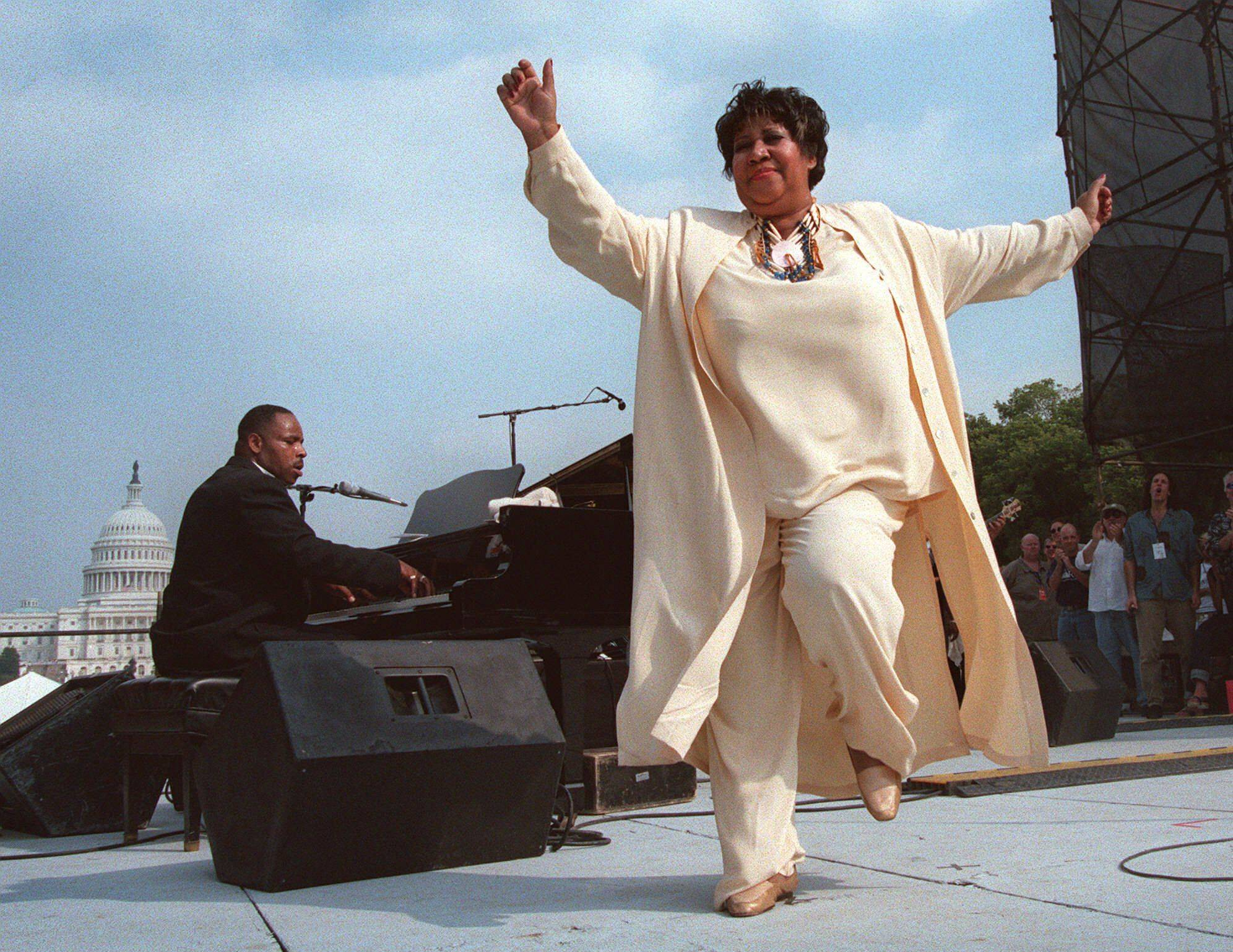 Singer Aretha Franklin dances on stage during the first annual march on cancer Saturday, Sept. 26, 1998, in Washington. The daylong event, known as ``The March,'' drew thousands of cancer survivors, patients, and loved ones descending on the National Mall to remember cancer victims and to ask for more research funds.