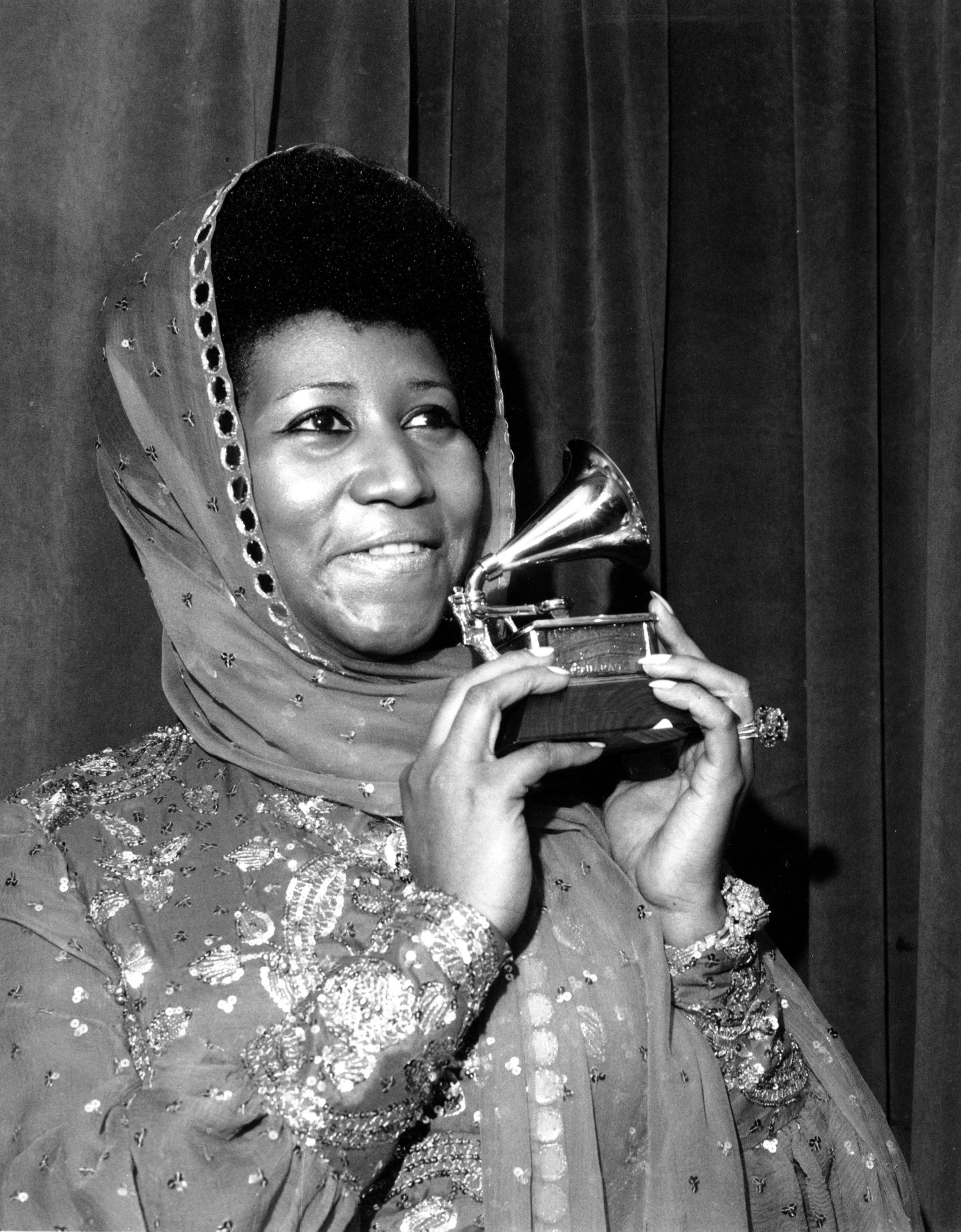 "Singer Aretha Franklin poses with her Grammy Award at the 17th Annual Grammy Award presentation in New York on March 3, 1975. The award is for her performance in ""Ain't Nothing Like the Real Thing."" Franklin has won every Grammy Award for ""Best Rhythm and Blues Performance, Female"" since this category was created in 1968."