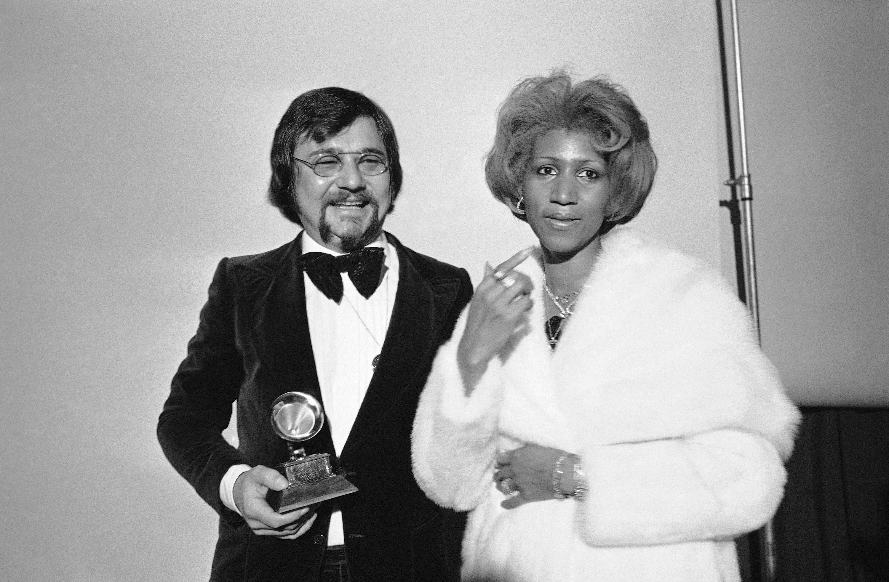 Sylvester Levay and Aretha Franklin,right, are shown at the Grammy Awards in Los Angeles, Feb. 28, 1976.