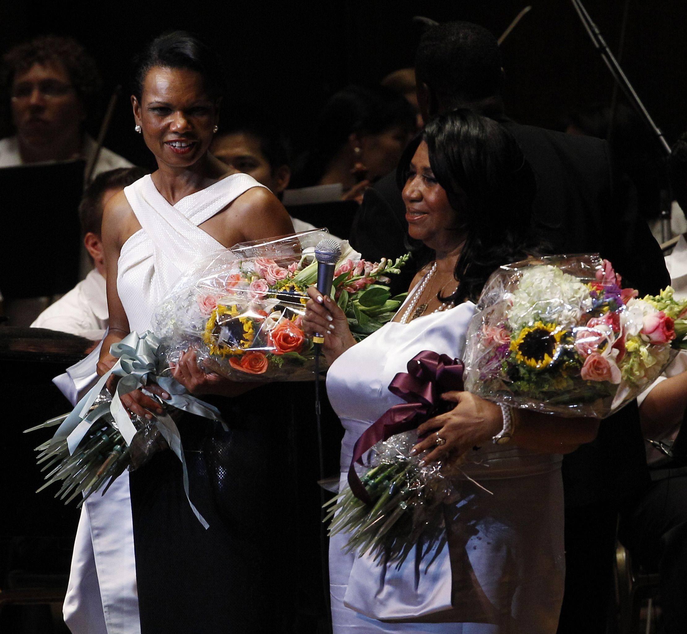 Former U.S. Secretary of State Condoleezza Rice and Aretha Franklin pose after they performed their first song together at The Mann Center for the Performing Arts in Philadelphia, Tuesday, July 27, 2010.