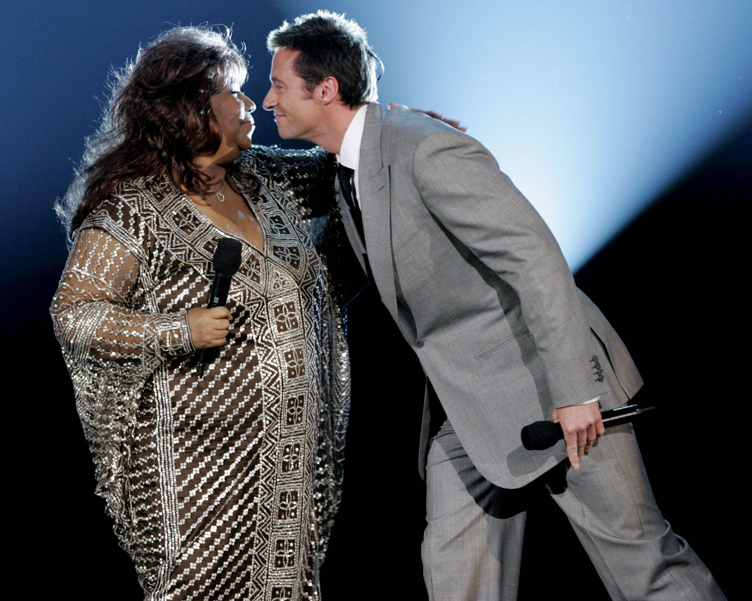 Host Hugh Jackman, right, leans to kiss Aretha Franklin after they sang together at the 2005 Tony Awards at Radio City Music Hall in New York on Sunday, June 5, 2005.