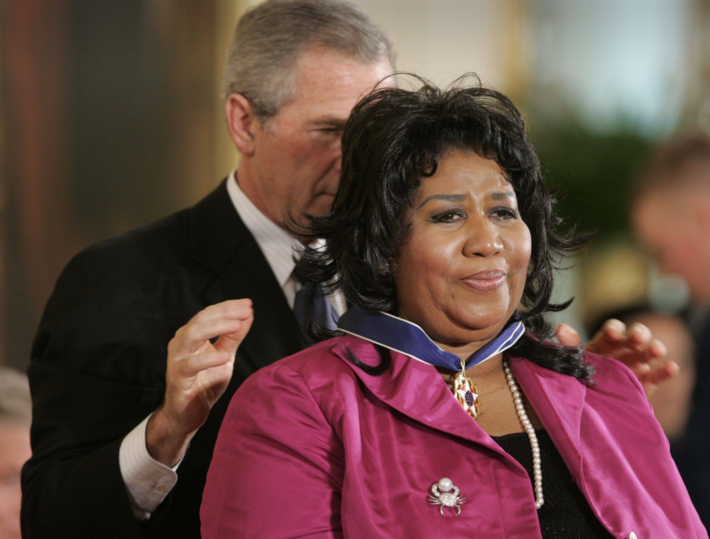 President Bush awards singer Aretha Franklin the Presidential Medal of Freedom Award in the East Room of the White House, Wednesday, Nov. 9, 2005, in Washington.
