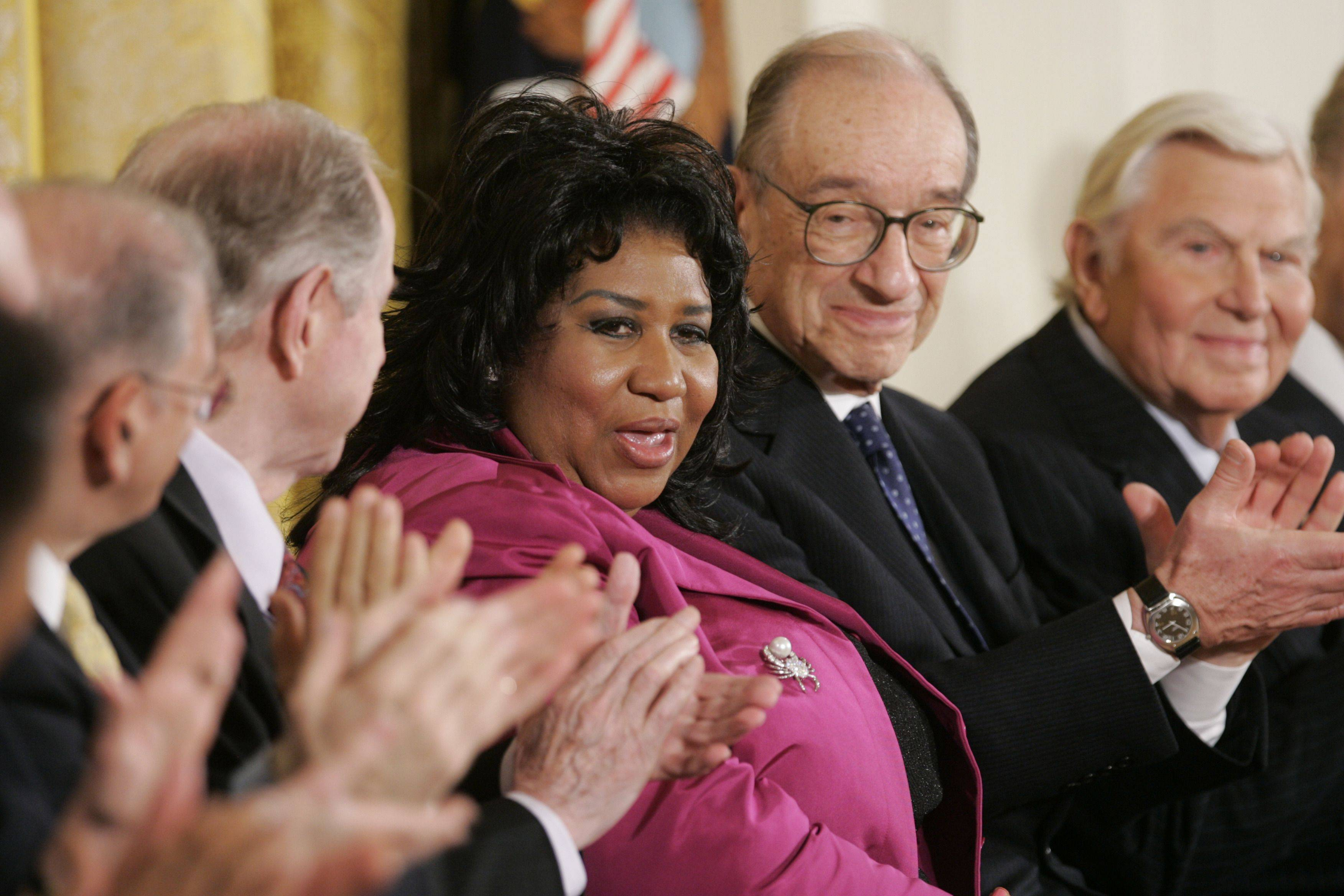 Soul singer Aretha Franklin, center, gets a round of applause after receiving the Presidential Medal of Freedom Award in the East Room of the White House, Wednesday, Nov. 9, 2005, in Washington. To the right is Federal Reserve chairman, Alan Greenspan, second from right, and actor Andy Griffith who were also recipients of the award.