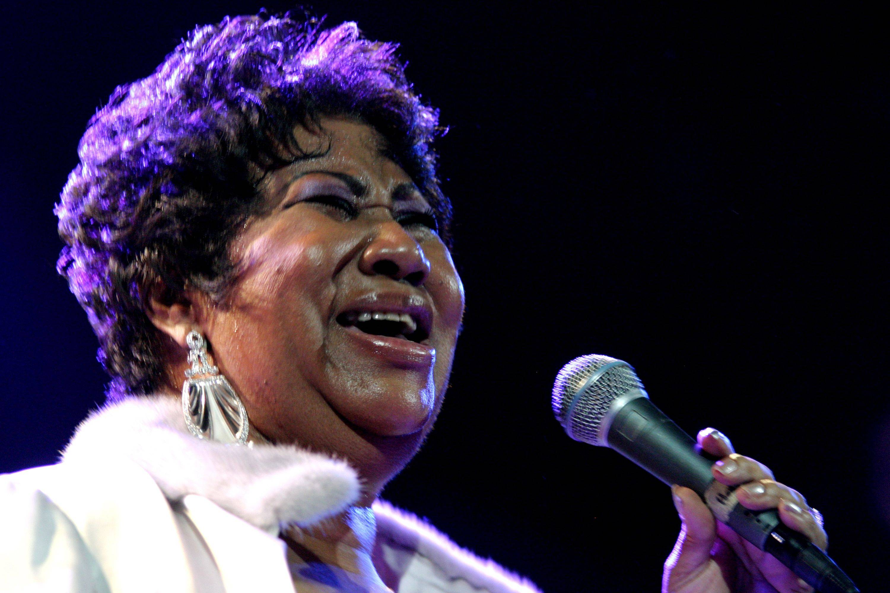 In this Nov. 21, 2008 file photo, Aretha Franklin performs at the House of Blues in Los Angeles.