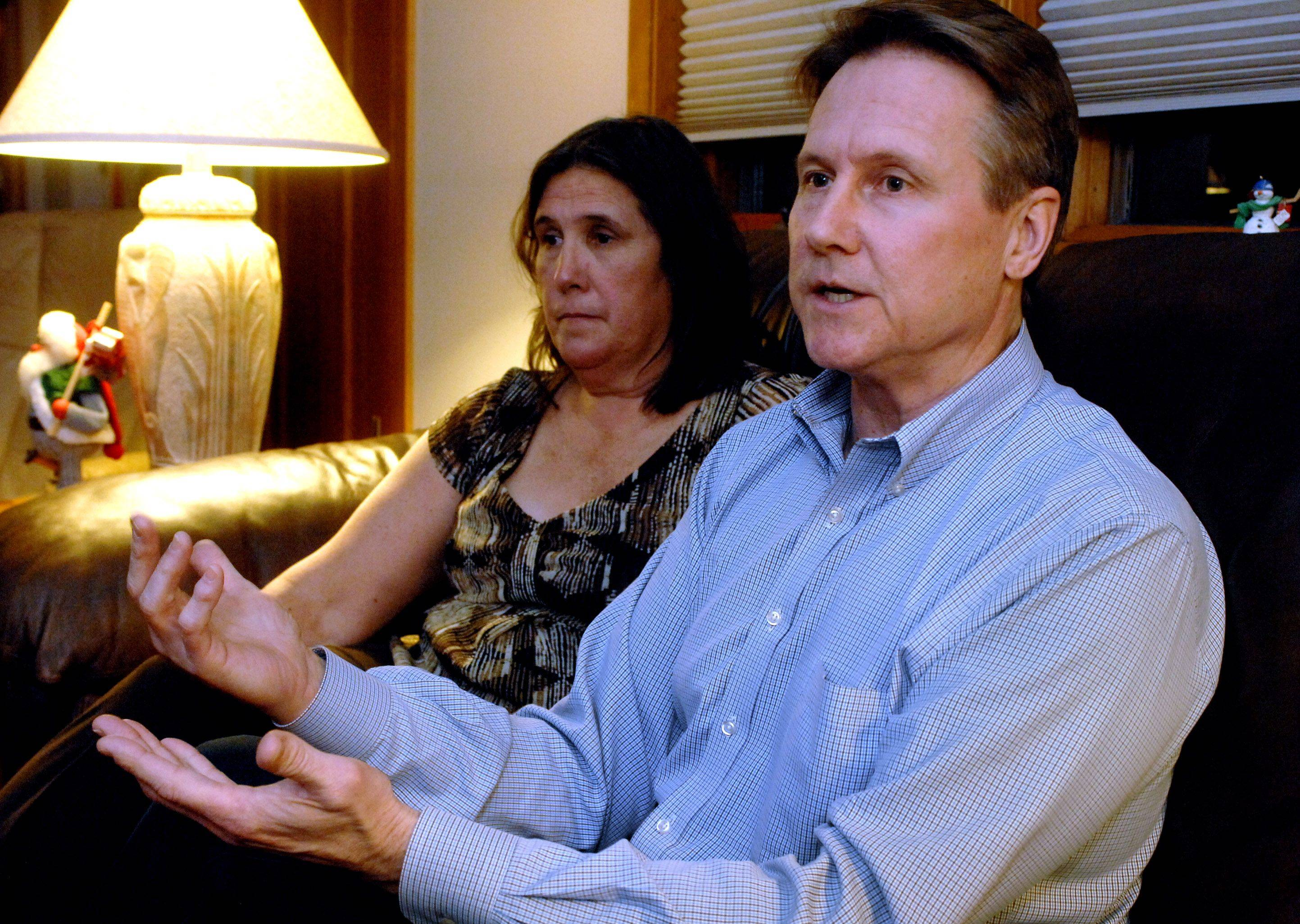 Steve Kotlinski, right, of Hawthorn Woods talks about the lawsuit he filed for being Tasered by Mundelein police officers in January. His wife, Jean, listens in Wednesday night.